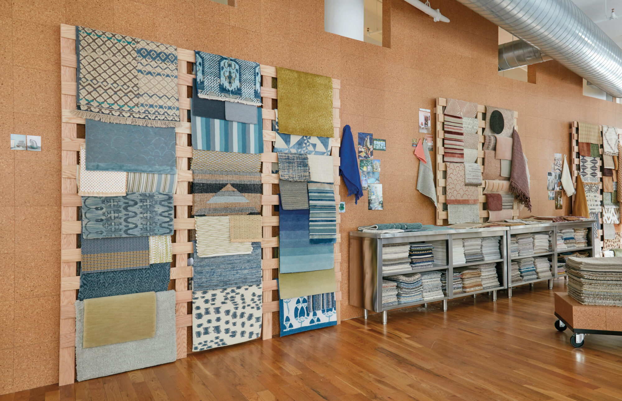 showroom with fabrics on wall