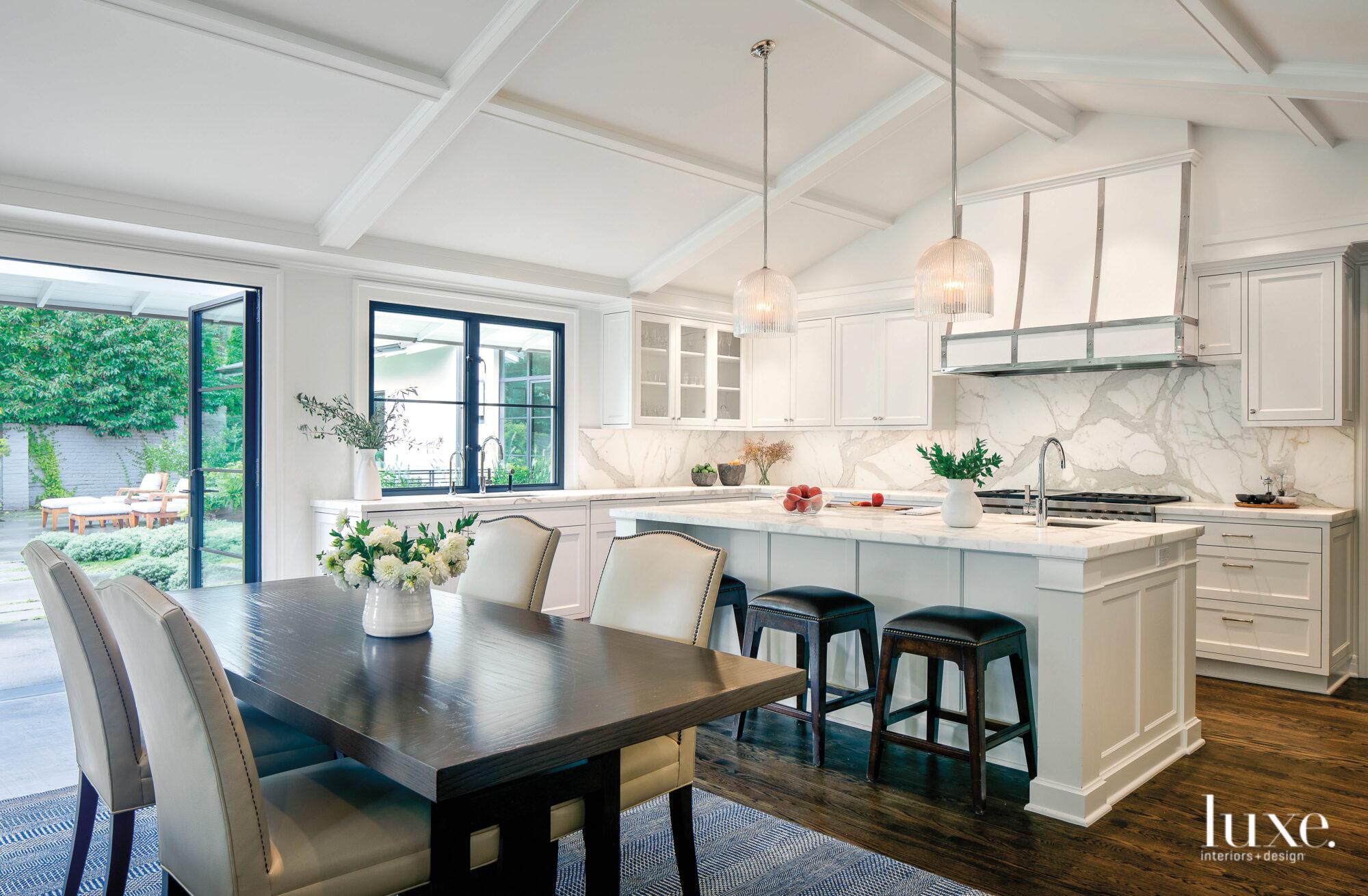 kitchen open door to patio white island