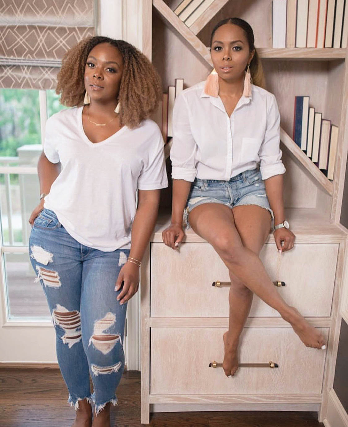 two designers wearing white shirts and jeans