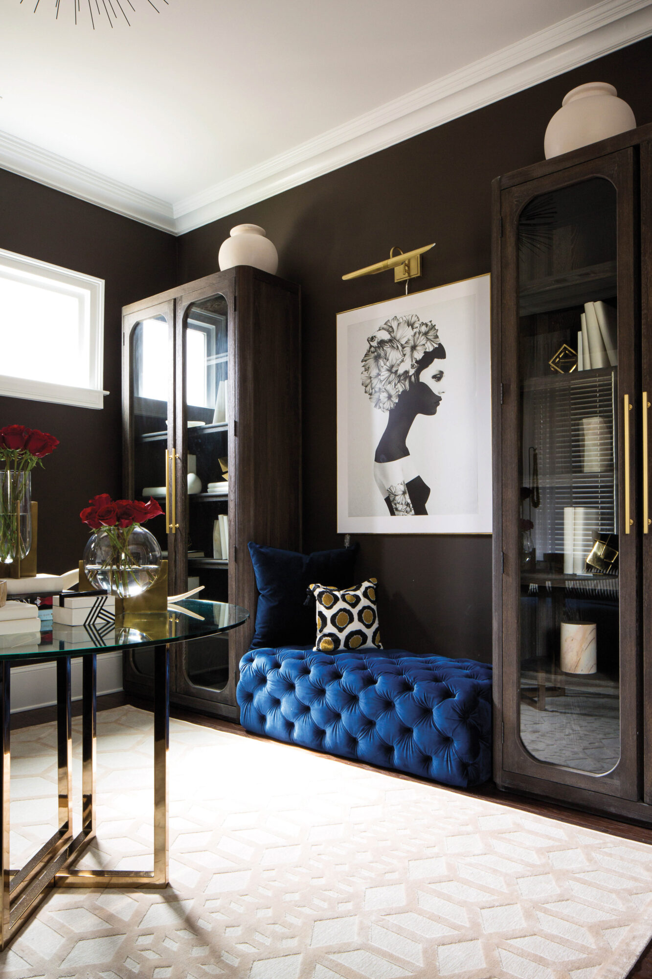 dark room with blue ottoman