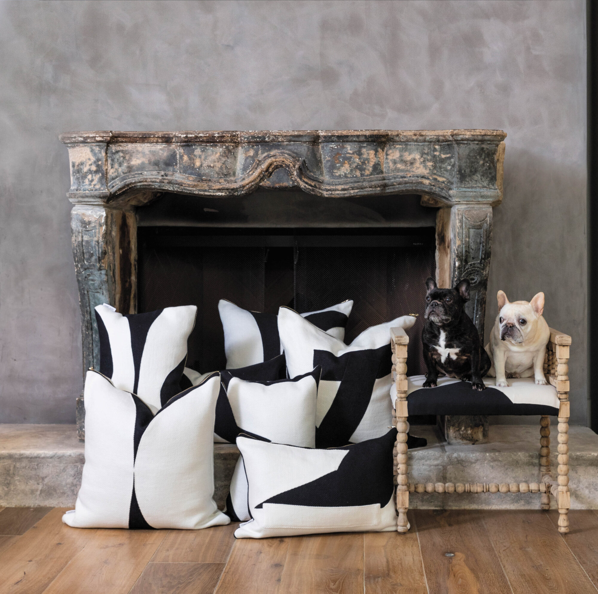 janet gust black white pillows in front of fireplace