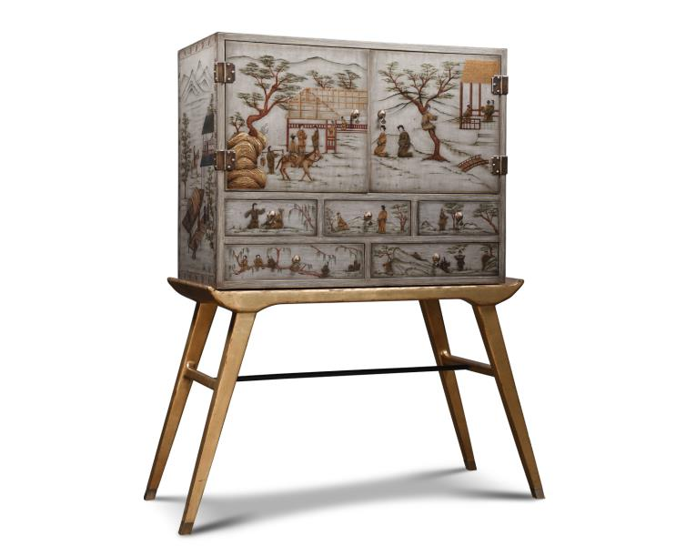 table with grey cabinet and pictures of homes and people
