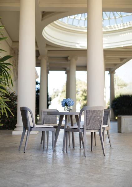 table outside with blue chairs