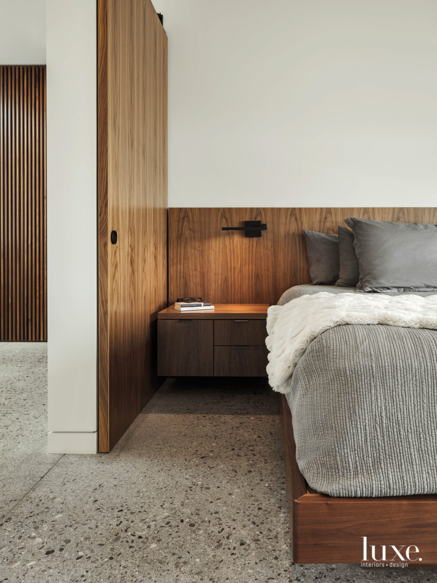 The homeowners' minimalist bedroom centers...