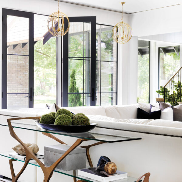 Love At First Sight: Farmhouse Style Abode In The Chicago Suburbs A white sectional in the living room, which opens to the outside.