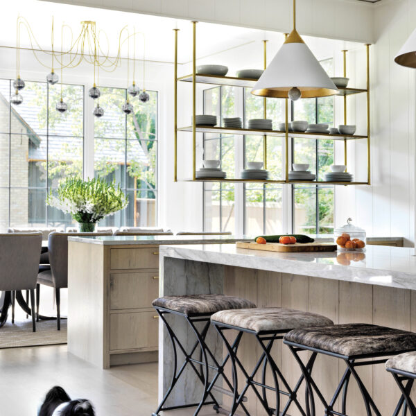 Love At First Sight: Farmhouse Style Abode In The Chicago Suburbs The kitchen has modern quartzite countertops and open hanging shelves.