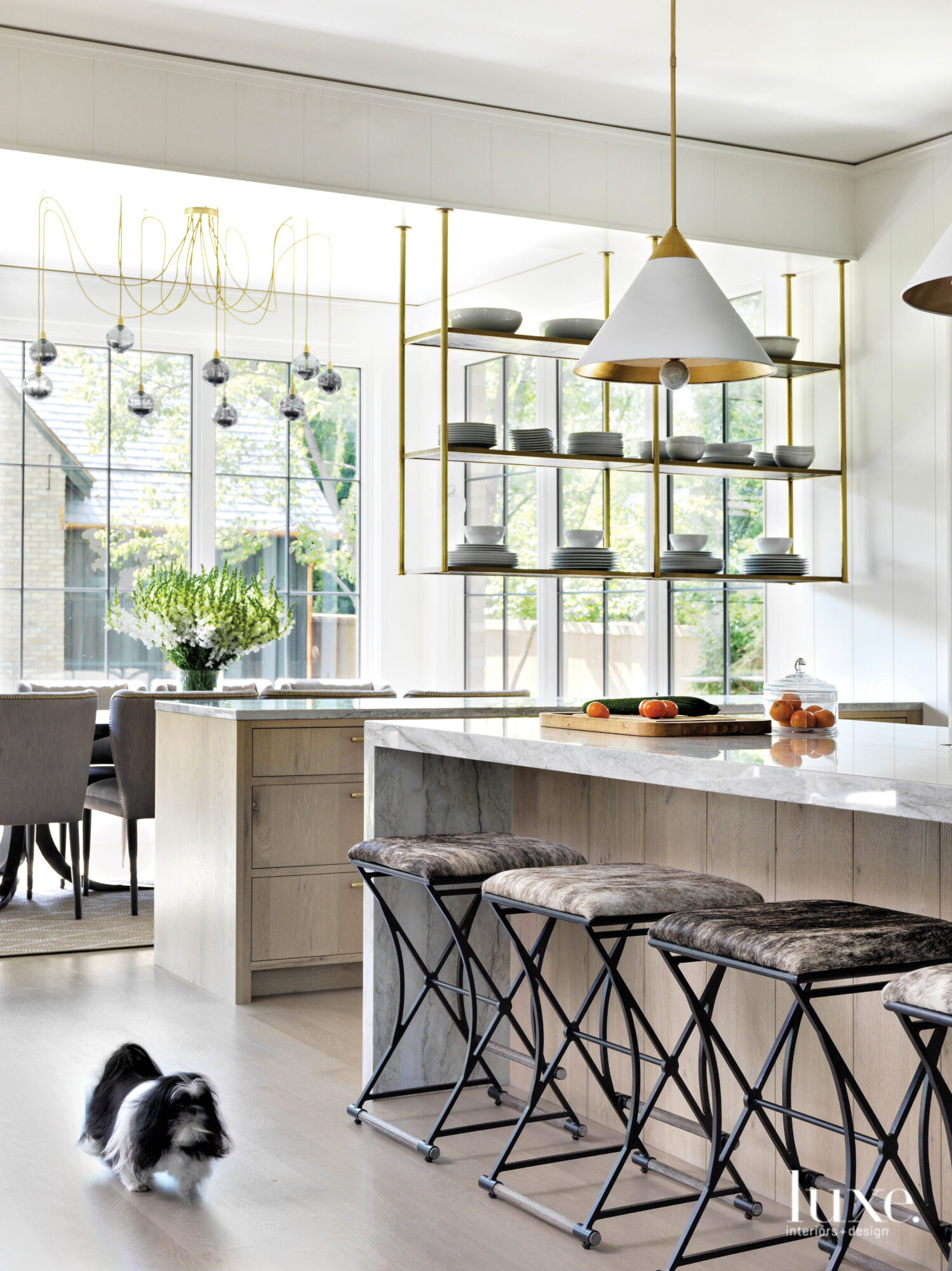 The kitchen has modern quartzite...