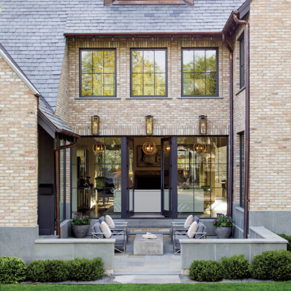 Love At First Sight: Farmhouse Style Abode In The Chicago Suburbs The patio view of a Belgian-bluestone modern farmhouse.