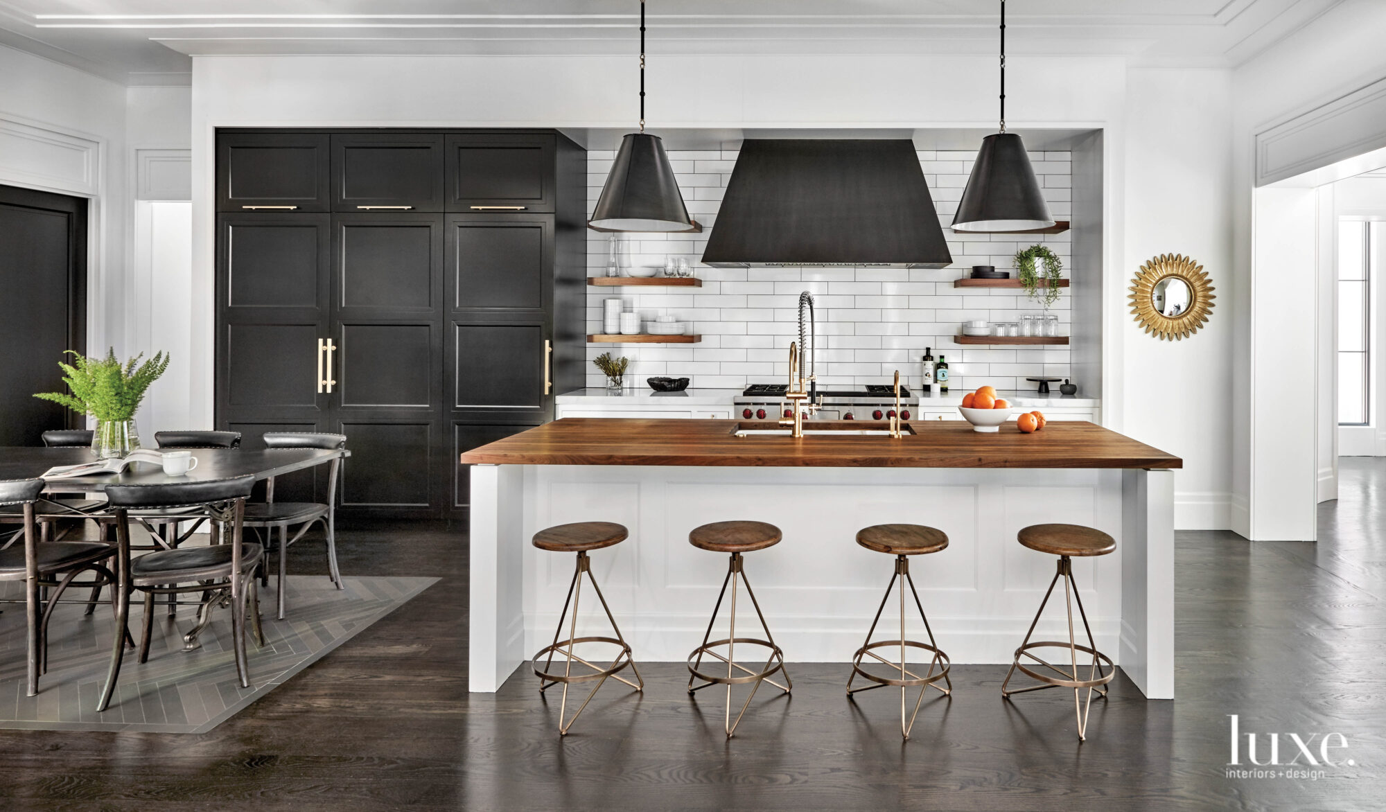 The black-and-white kitchen has a...