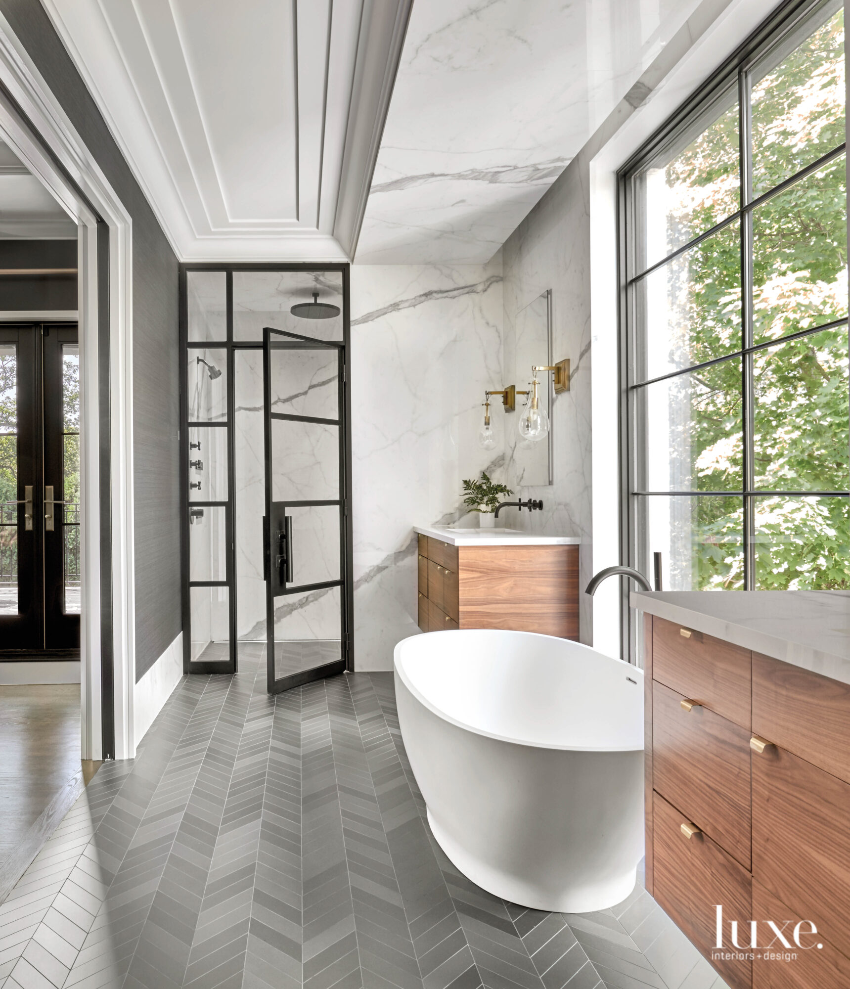 A free-standing tub sits in...