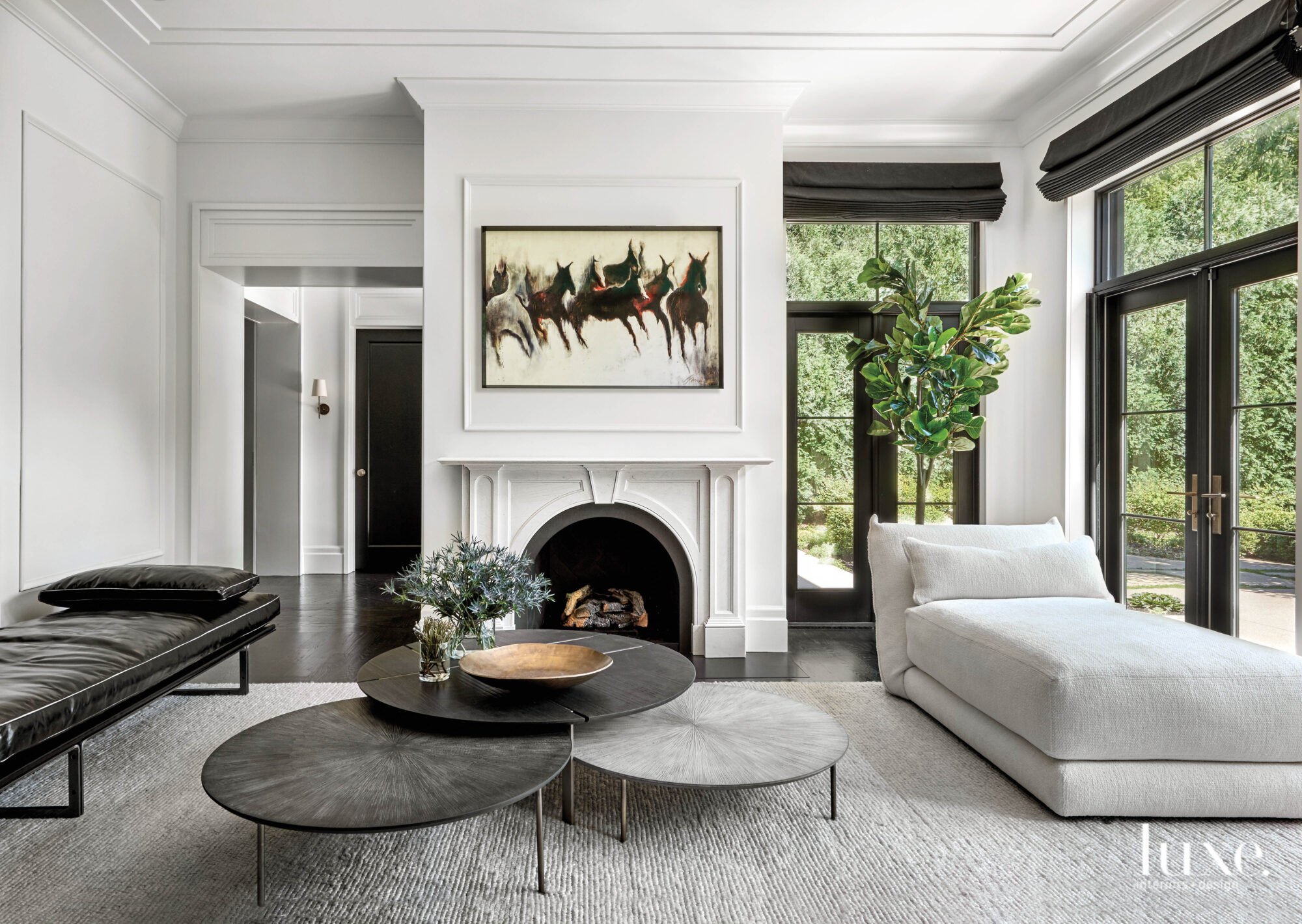 Neutral living room done in shades of black, gray and white.