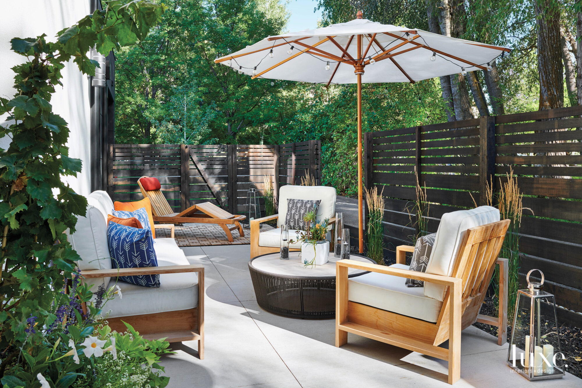 A patio features stylish teak...
