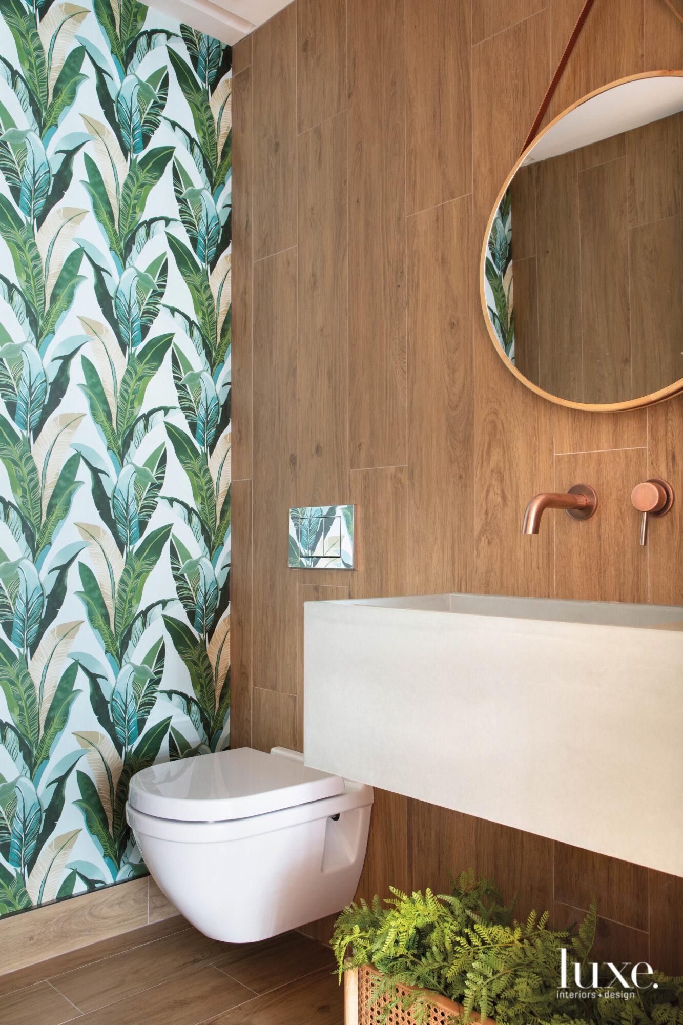 bathroom with banana leaf-print wallpaper