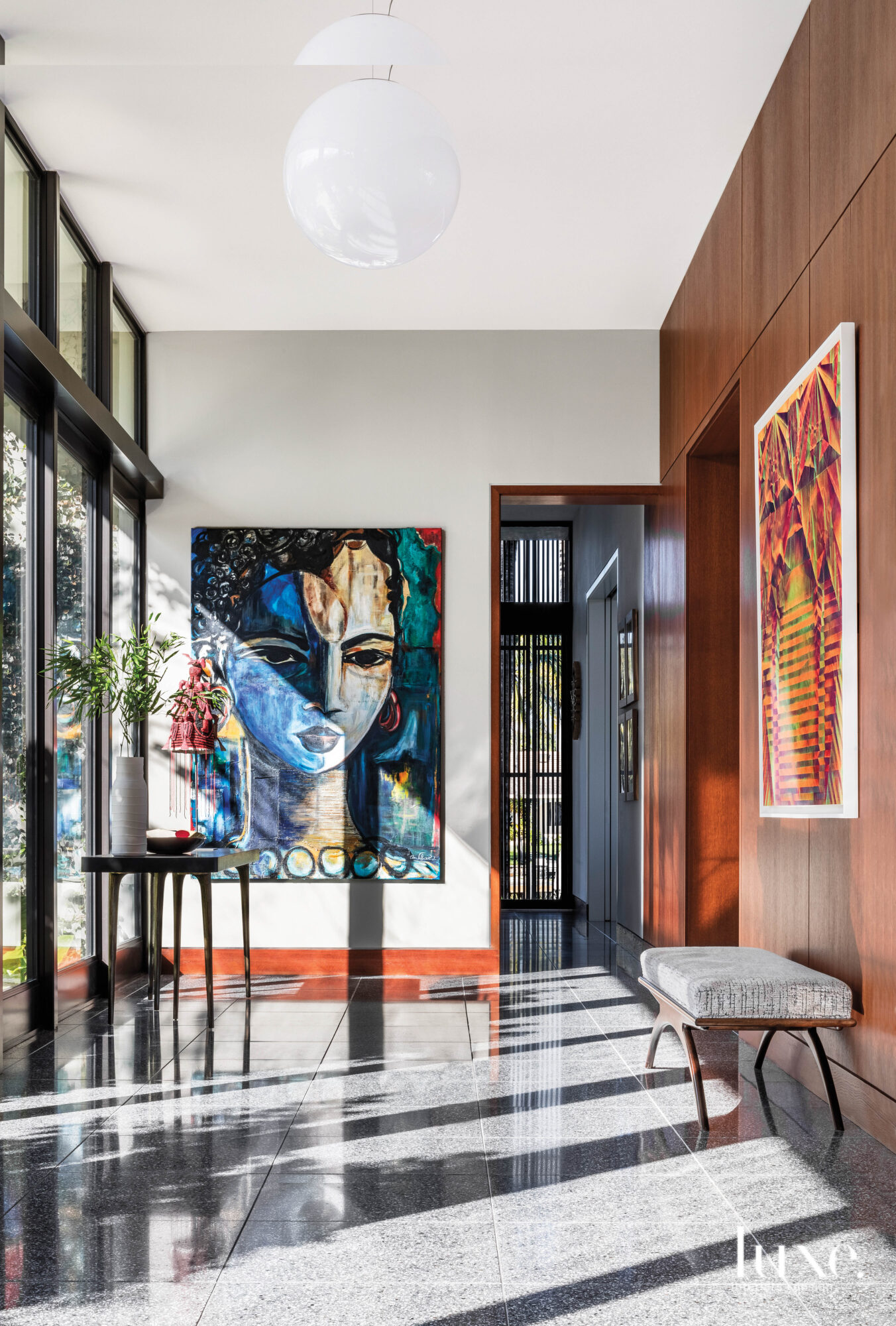 modern entry with vibrant artwork,...