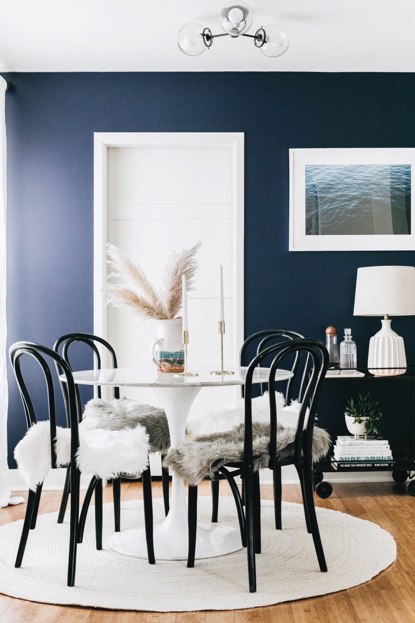dining room black chairs navy walls