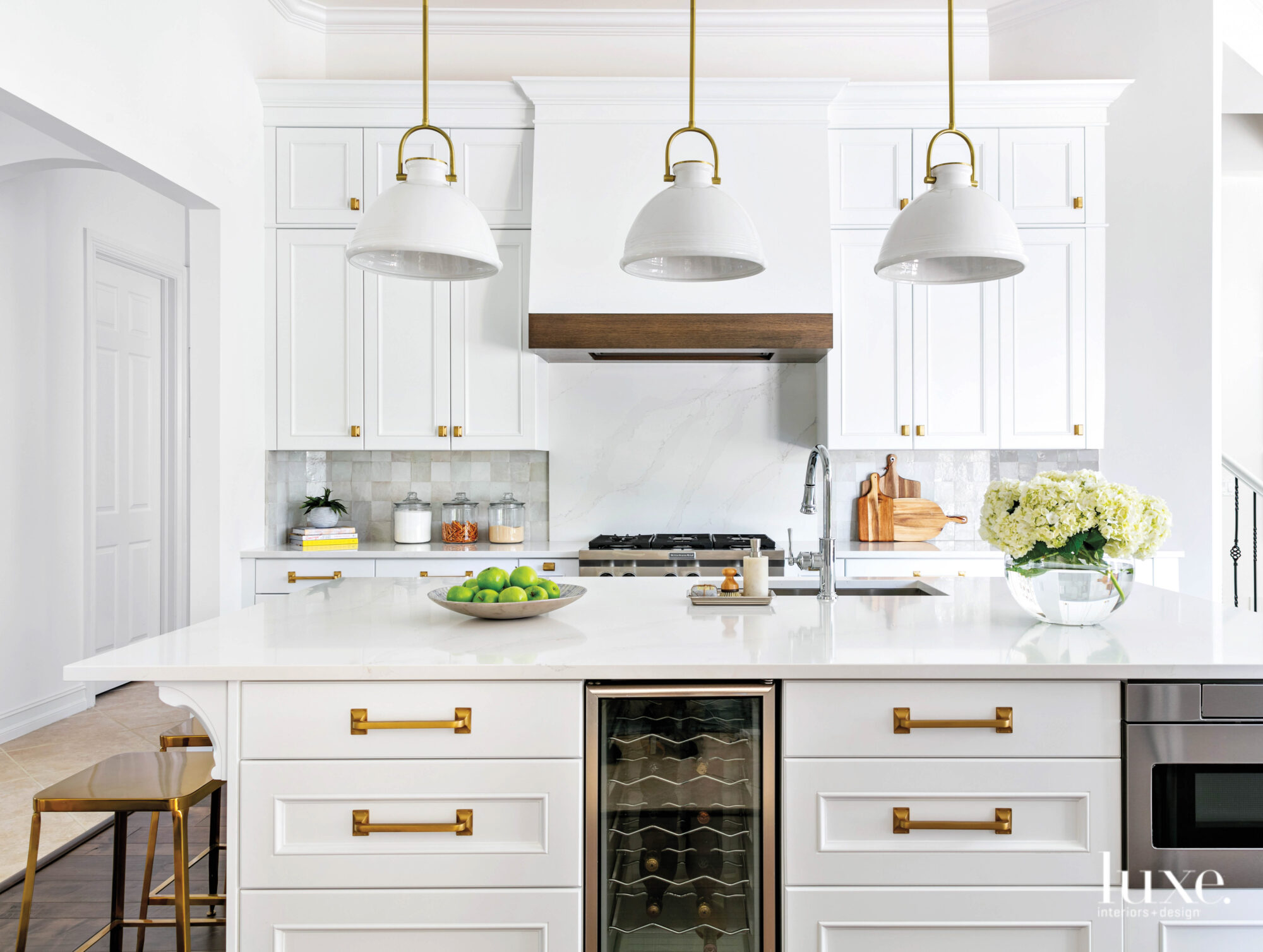 kitchen with white cabinetry and three hanging lanterns