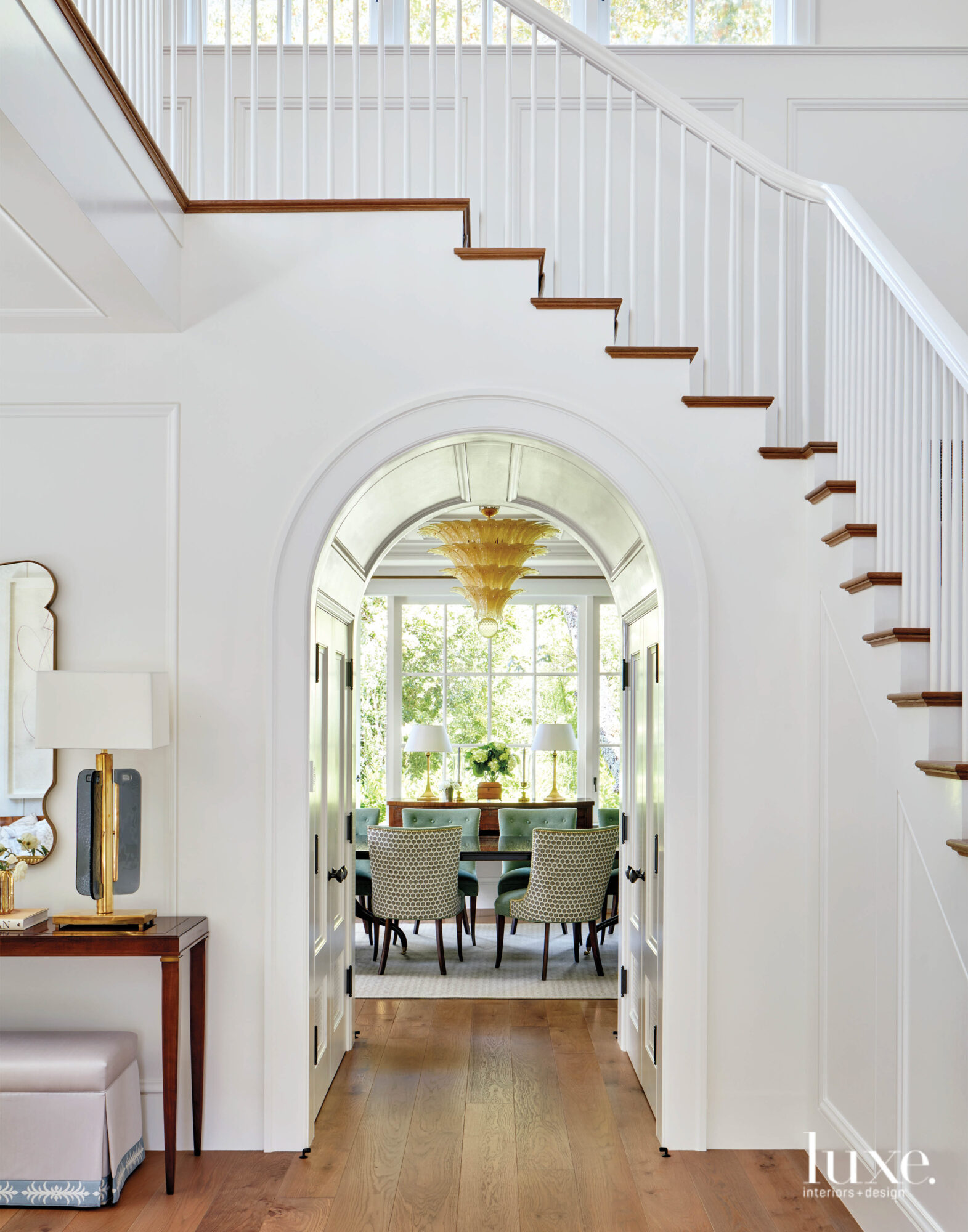 The entry features an arched passageway.