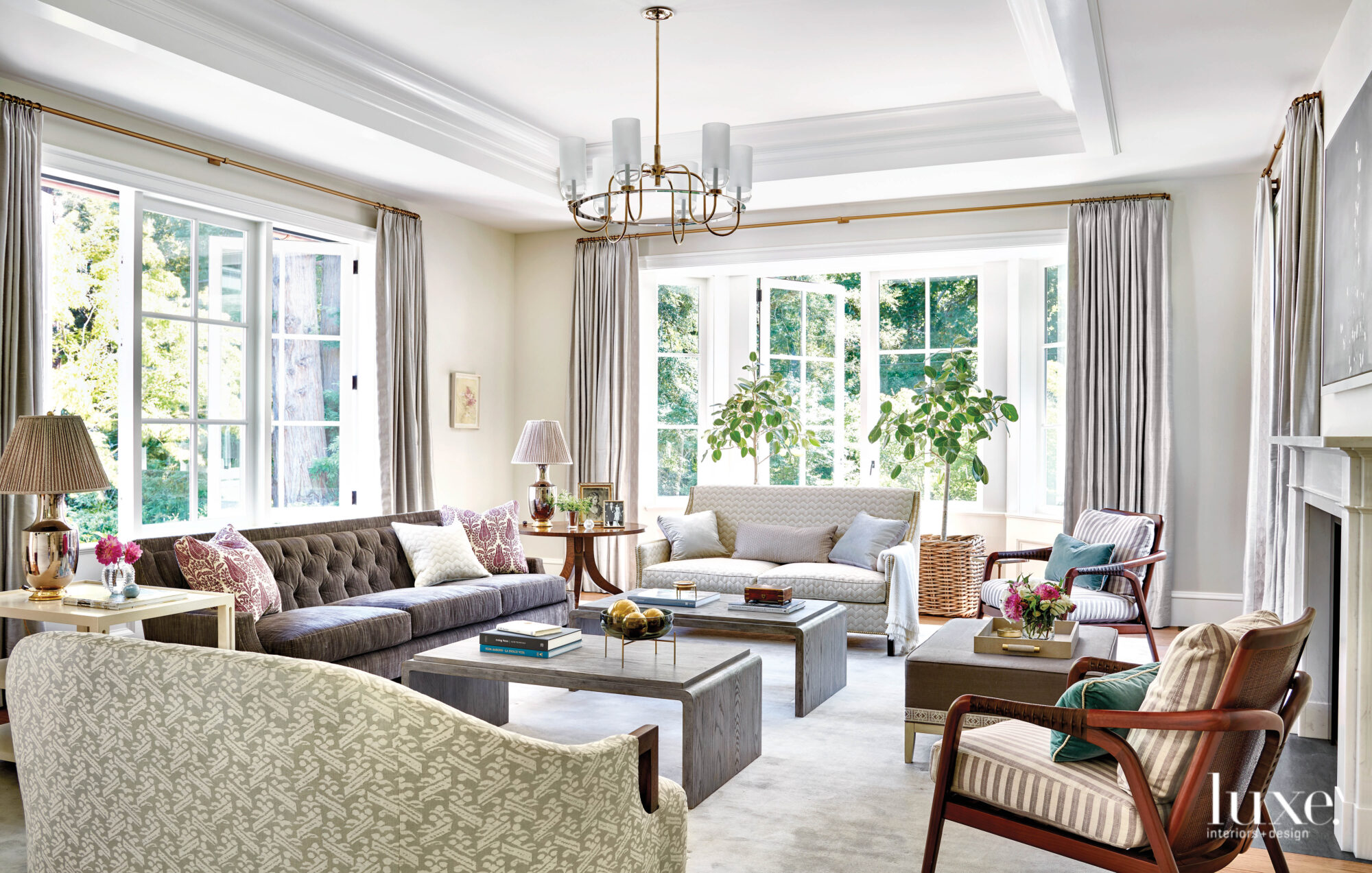 The living area has ample seating with three sofas and a pair of armchairs.