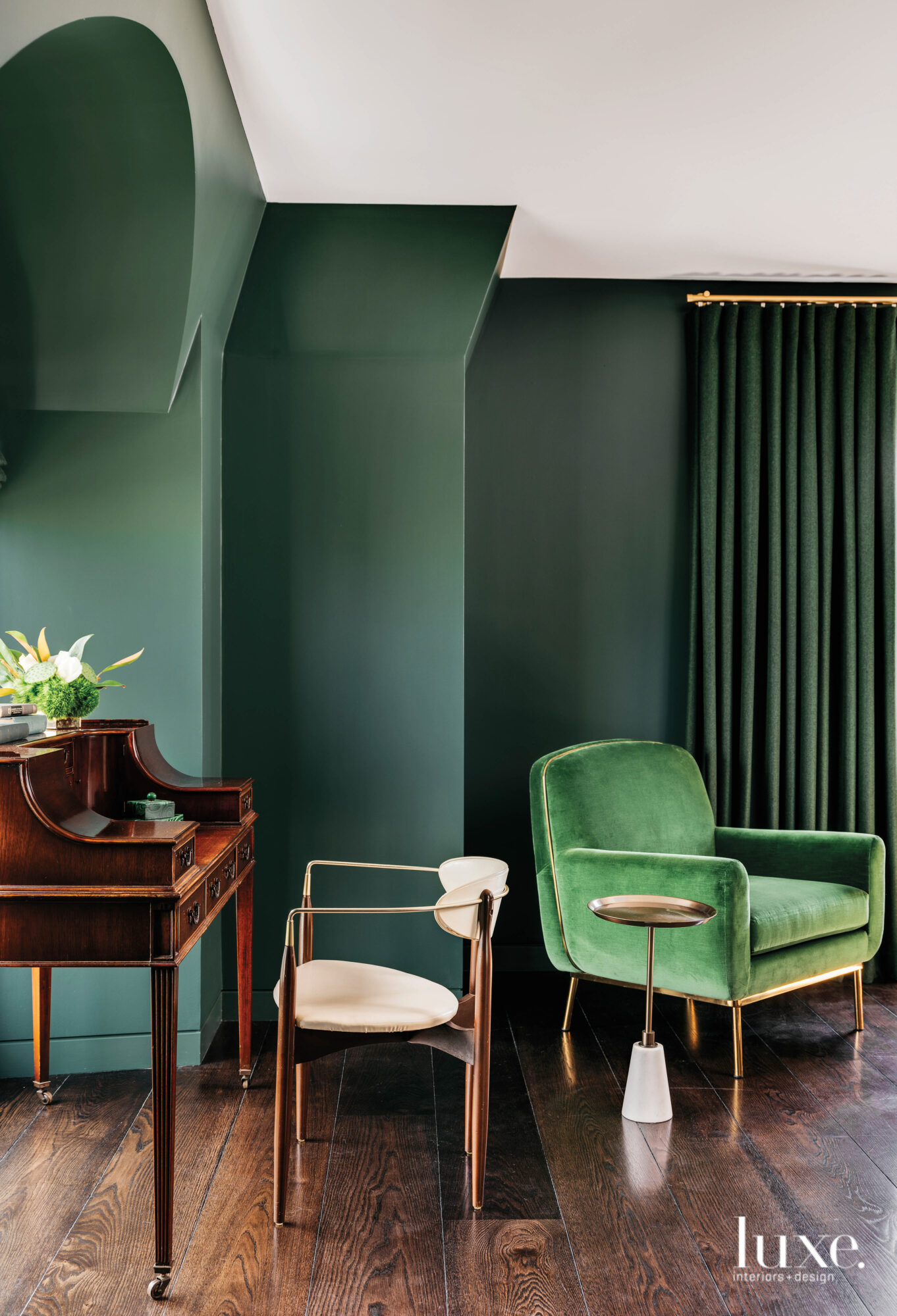 A guest room is done in shades of green.