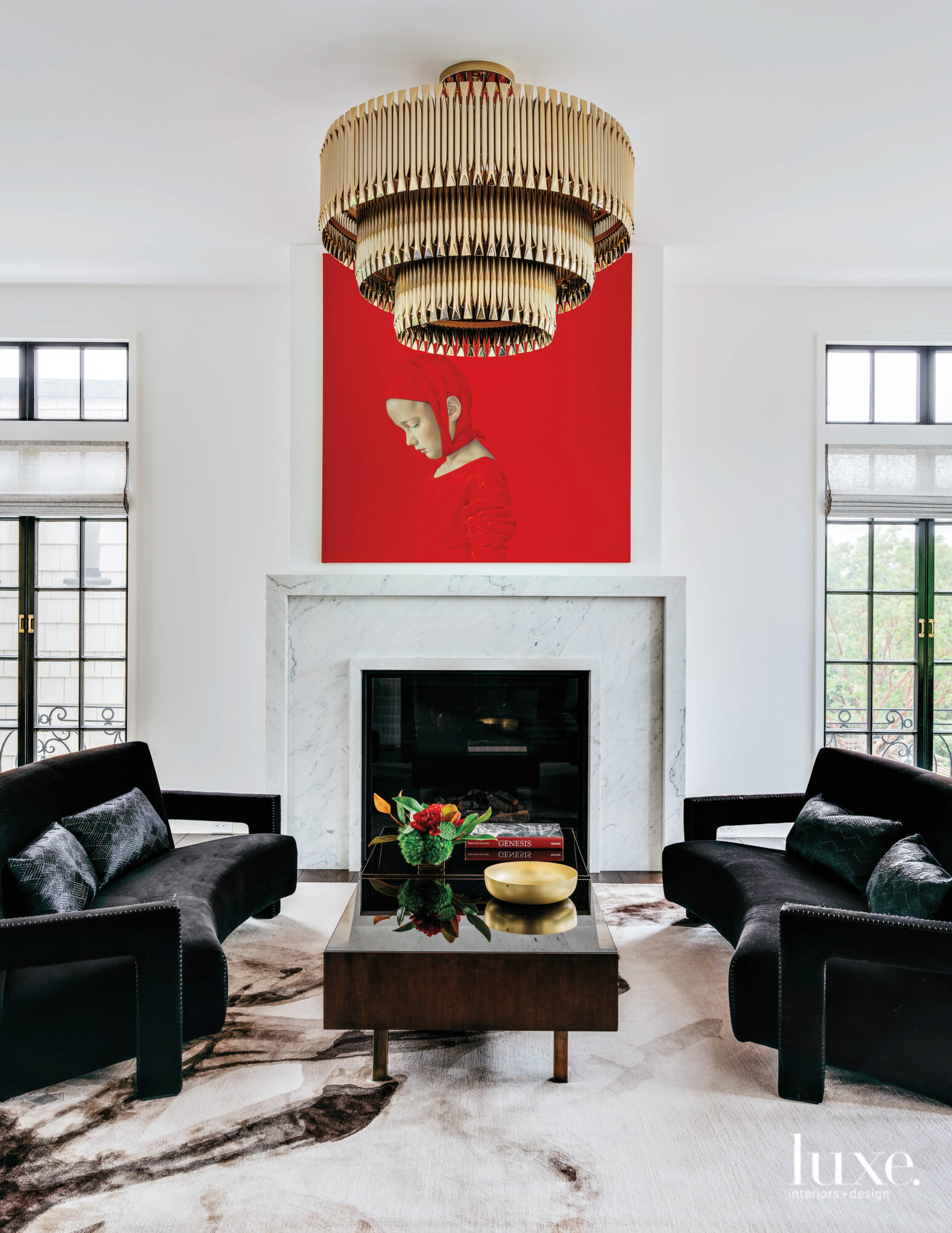 A black and white living room is the backdrop for a bright red artwork.