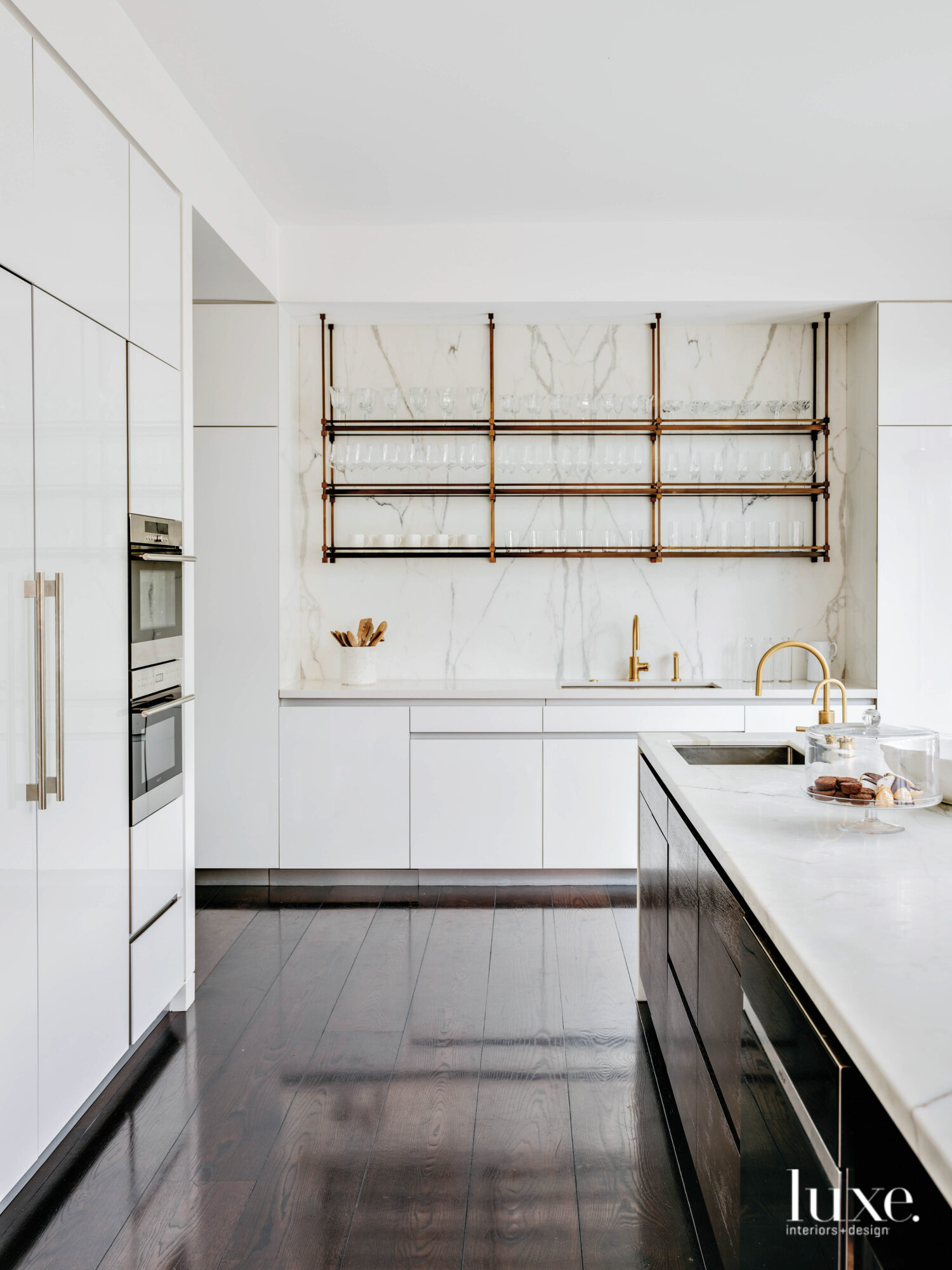 A kitchen features open shelving.