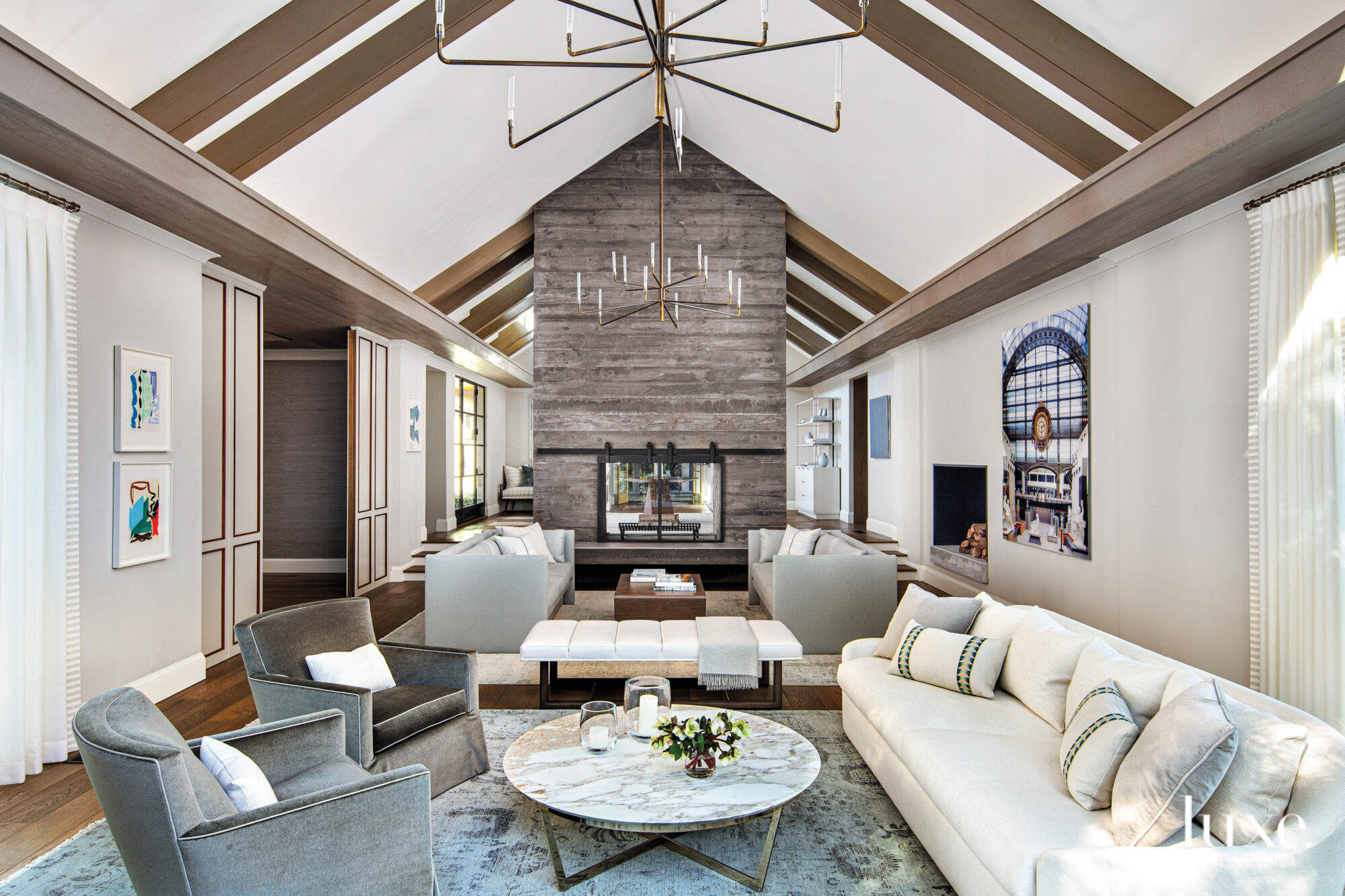 The living room features a seating area in front of the fireplace.