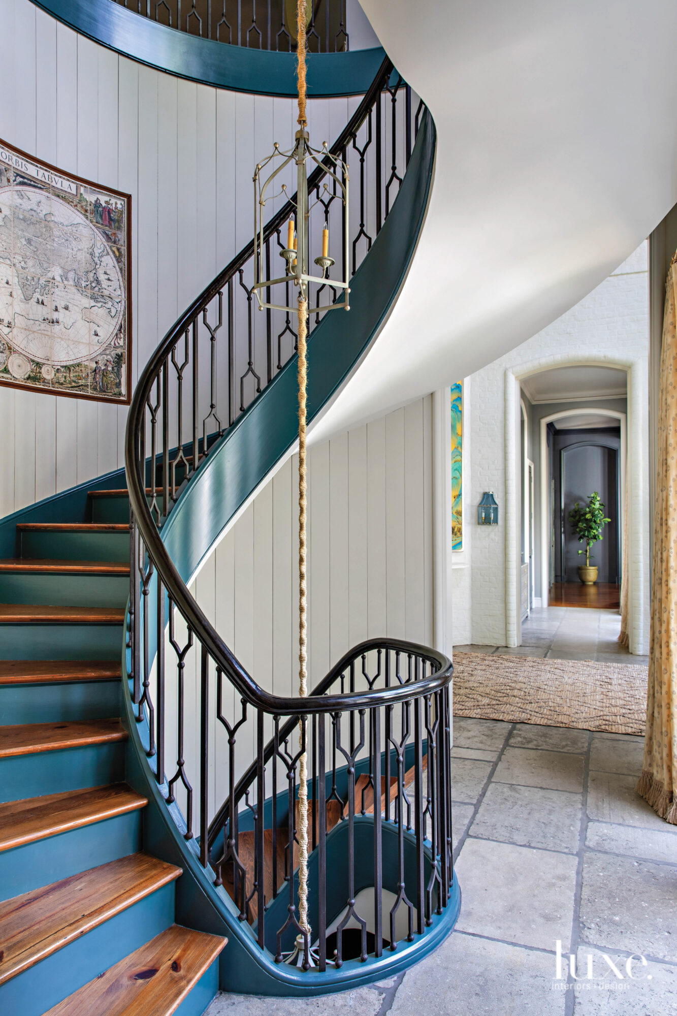 Spiral staircase with teal trim...