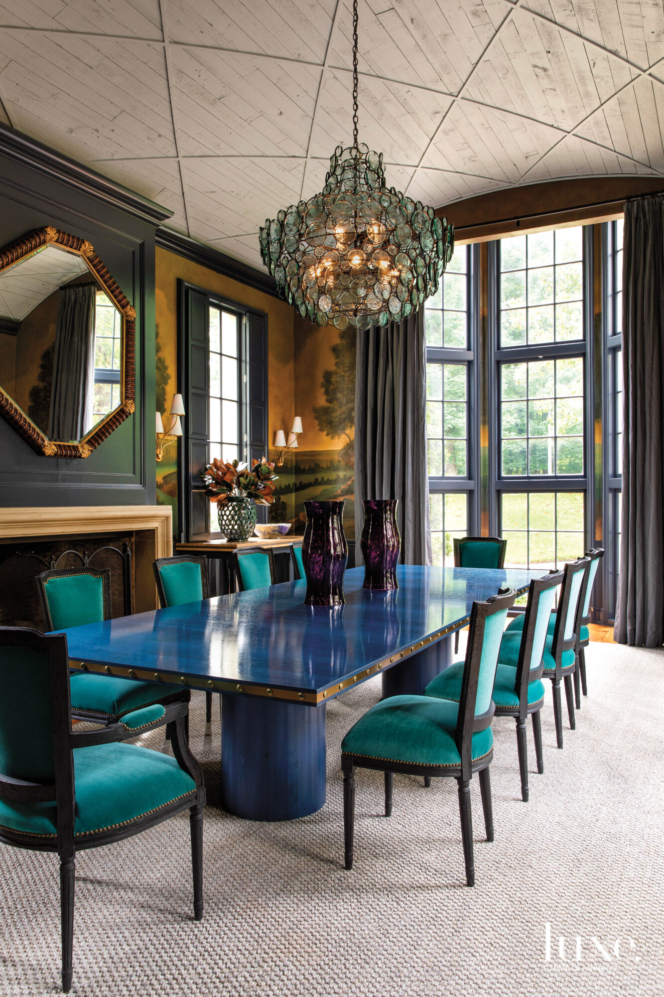 Dining room with scenic wallpaper,...
