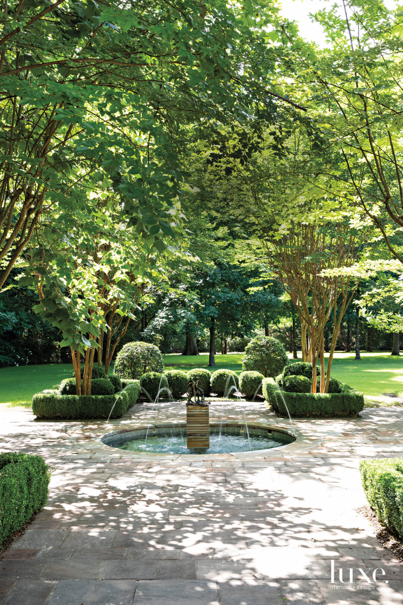 Garden with fountain, crepe myrtles and clipped boxwoods