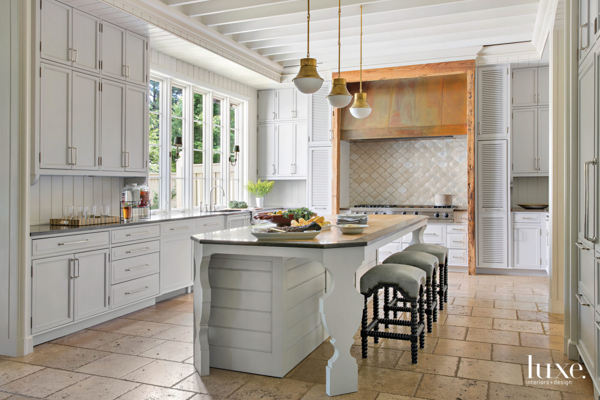 White kitchen with patinated details