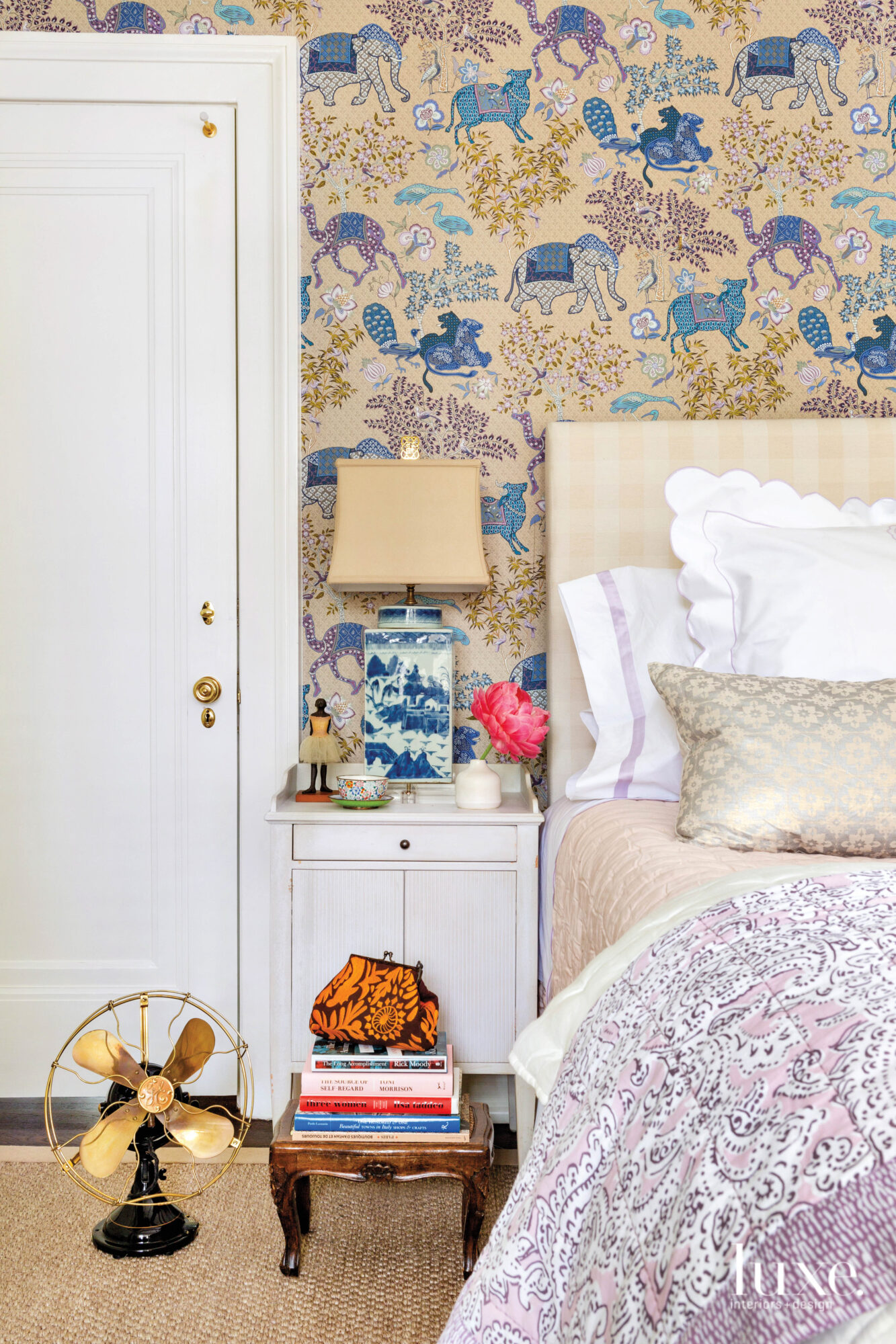 Bedroom with patterned wallpaper, a...