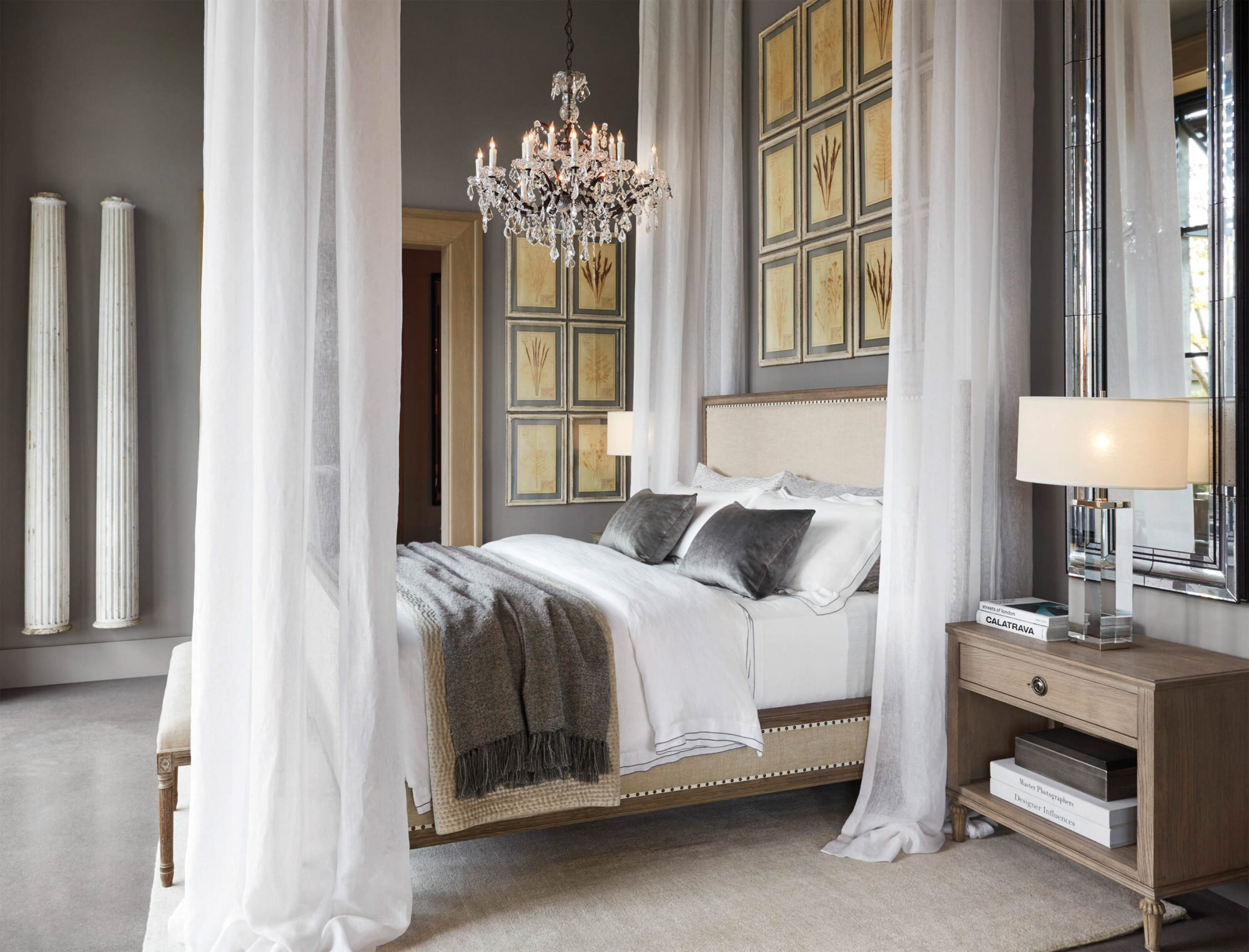 Sumptuous bed with crystal chandelier and panels surrounding it