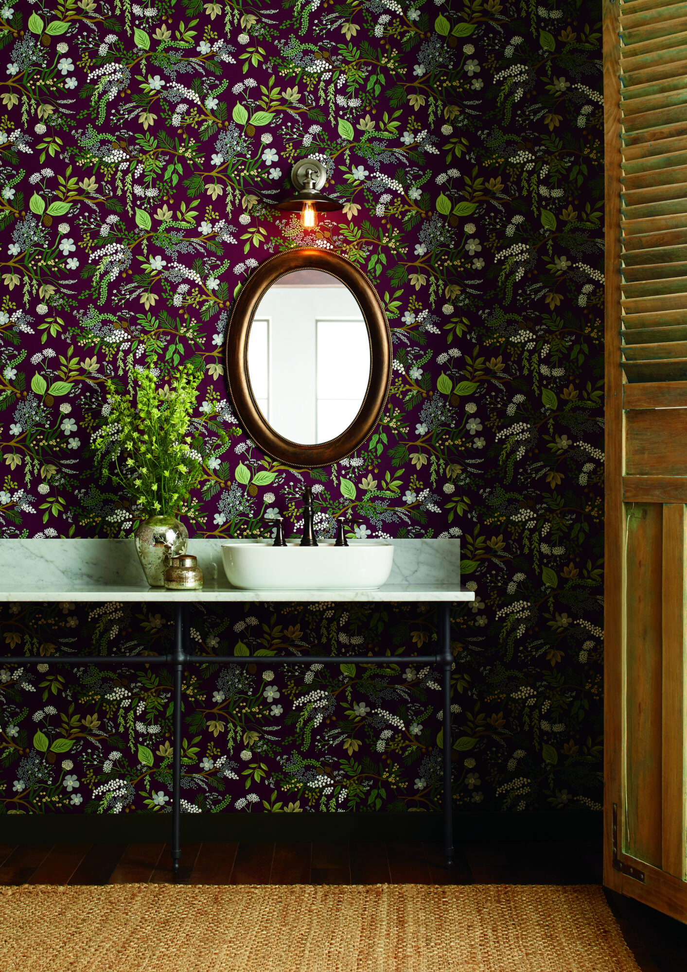 dark red and green forest wallpaper round mirror white sink