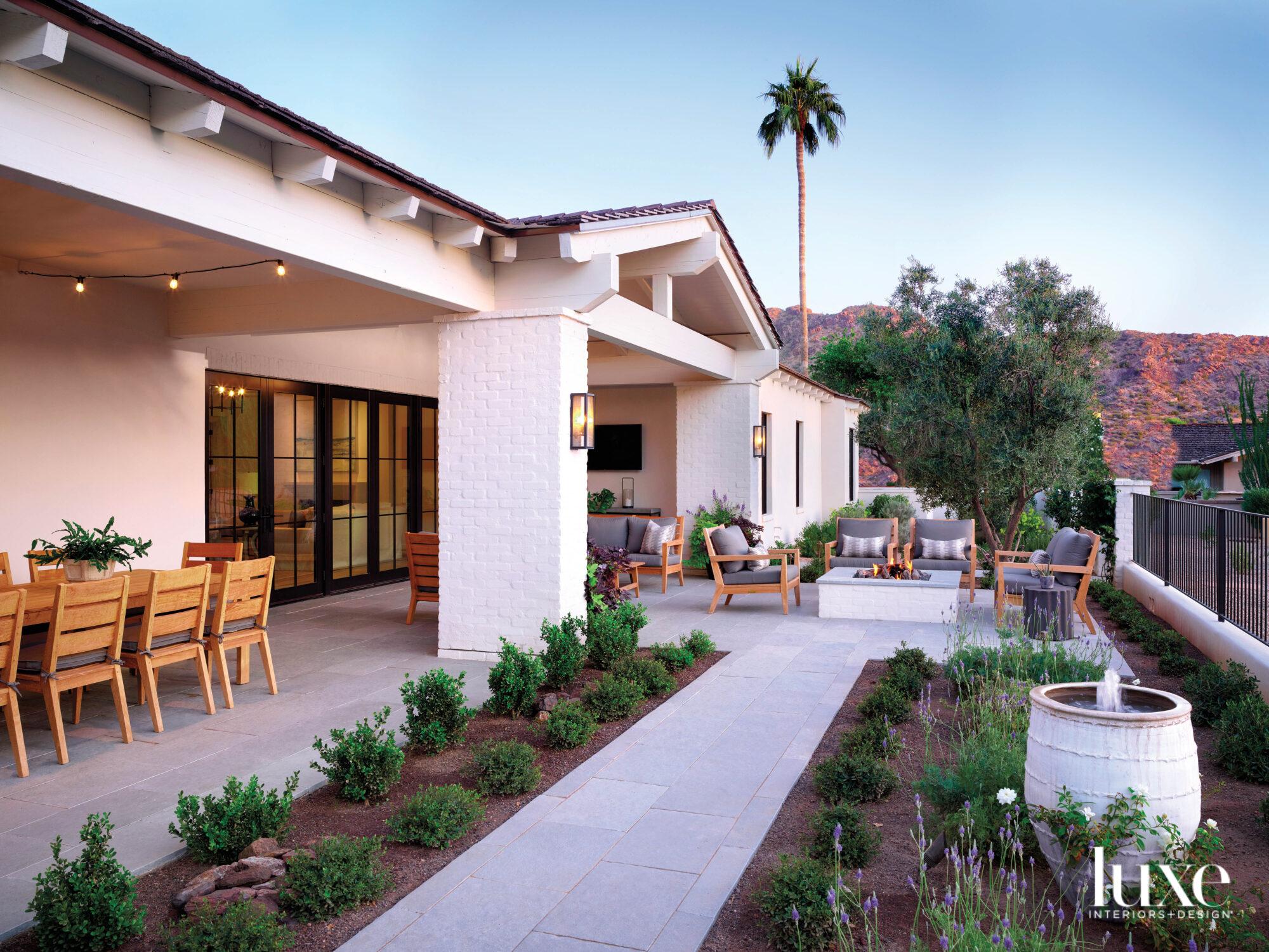 The patio of a white modern farmhouse.