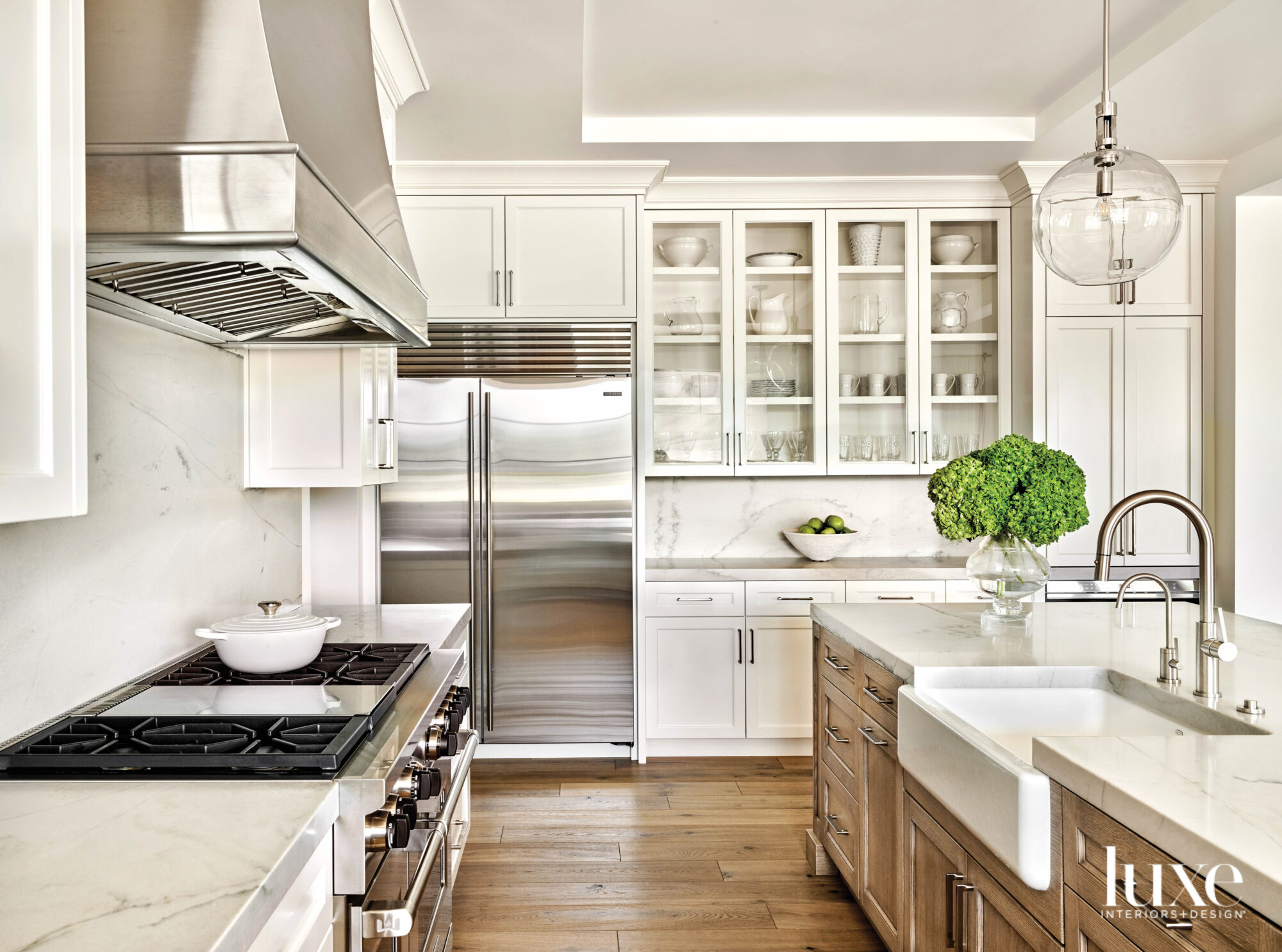 The kitchen has marble countertops and a farmhouse sink.