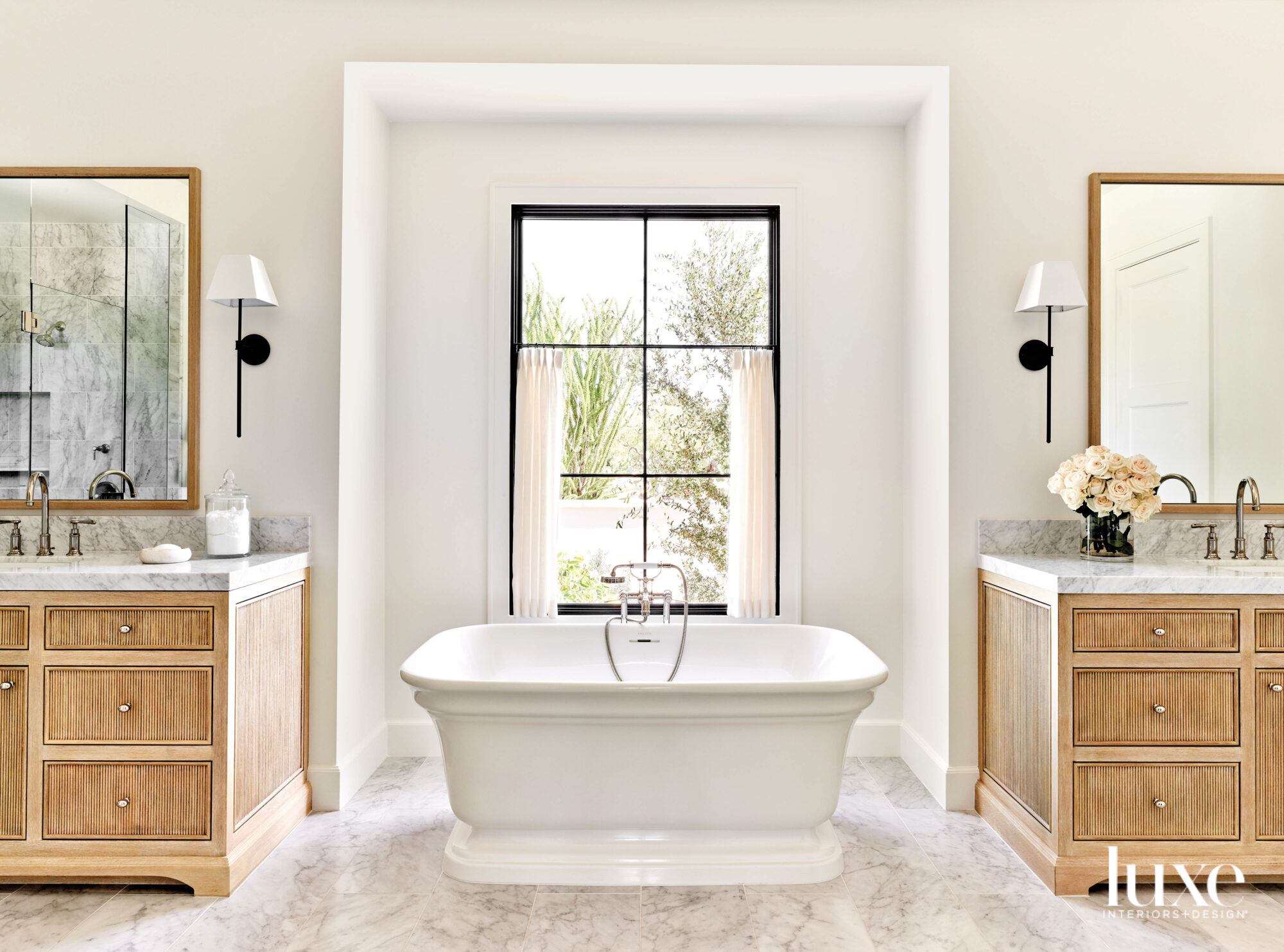 A standalone tub in front...
