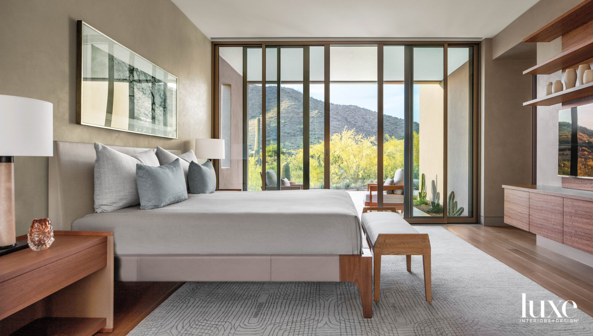 A neutral-hued bedroom with natural...