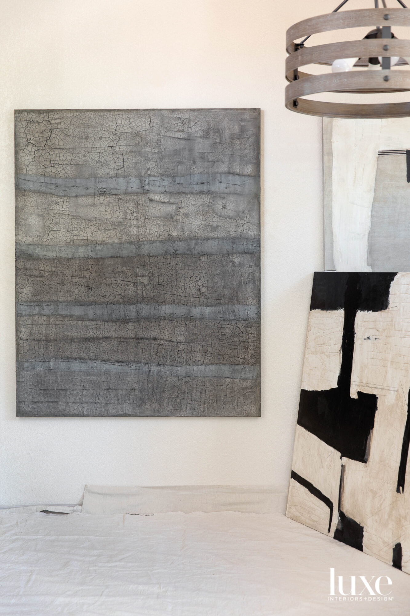 One gray painting on the left and a black-and-white painting on the right.