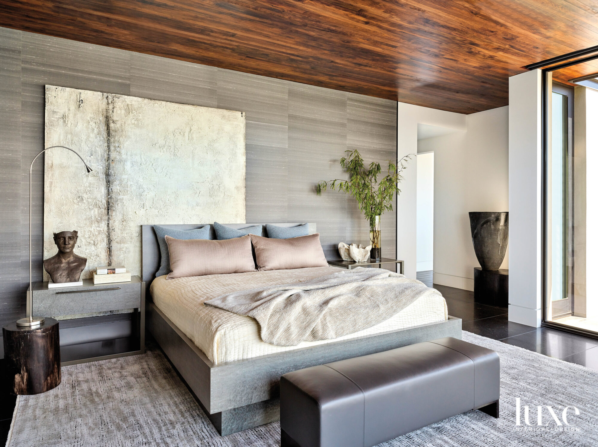 A gray bedroom with a...