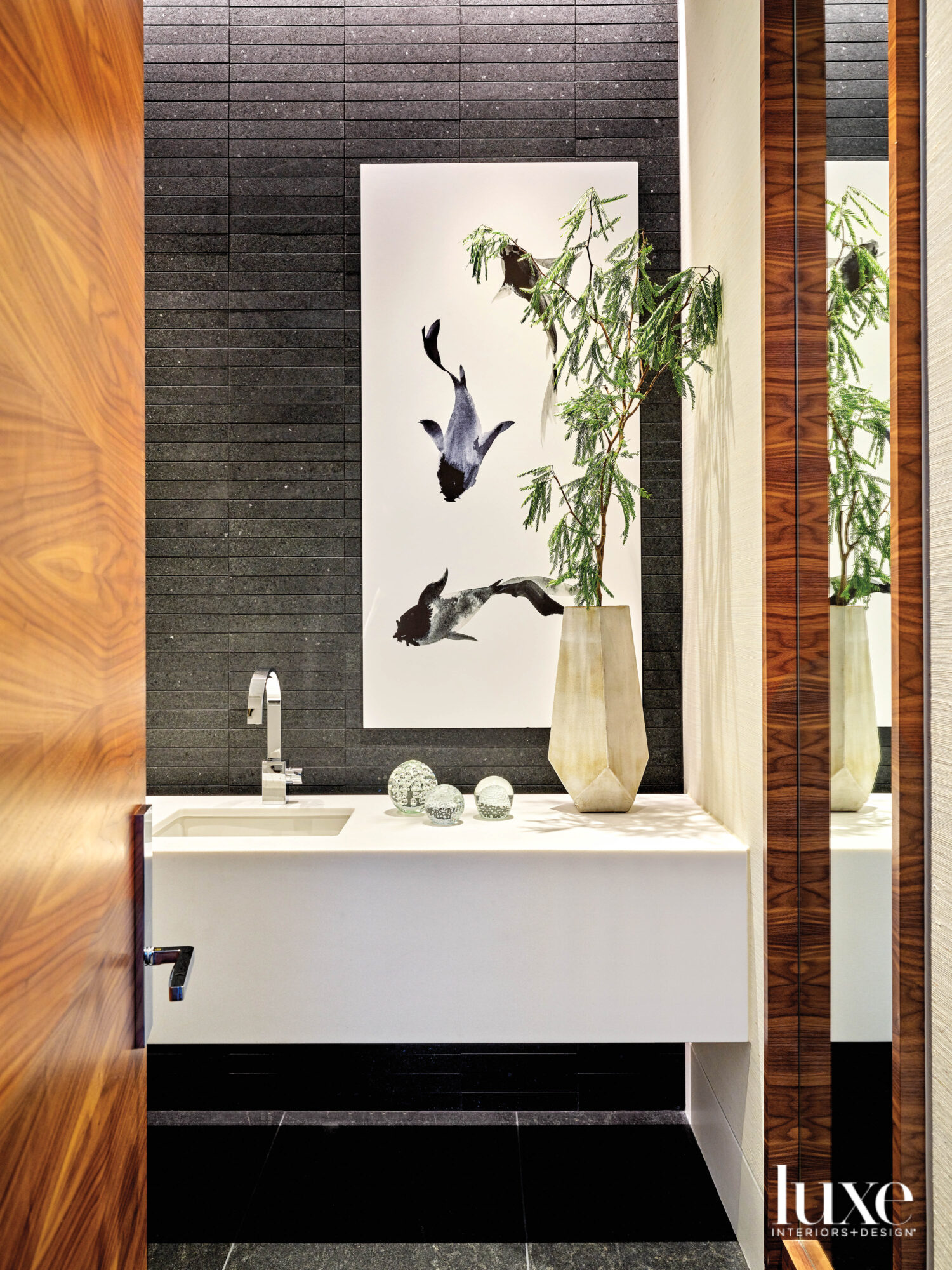 A powder room with black...