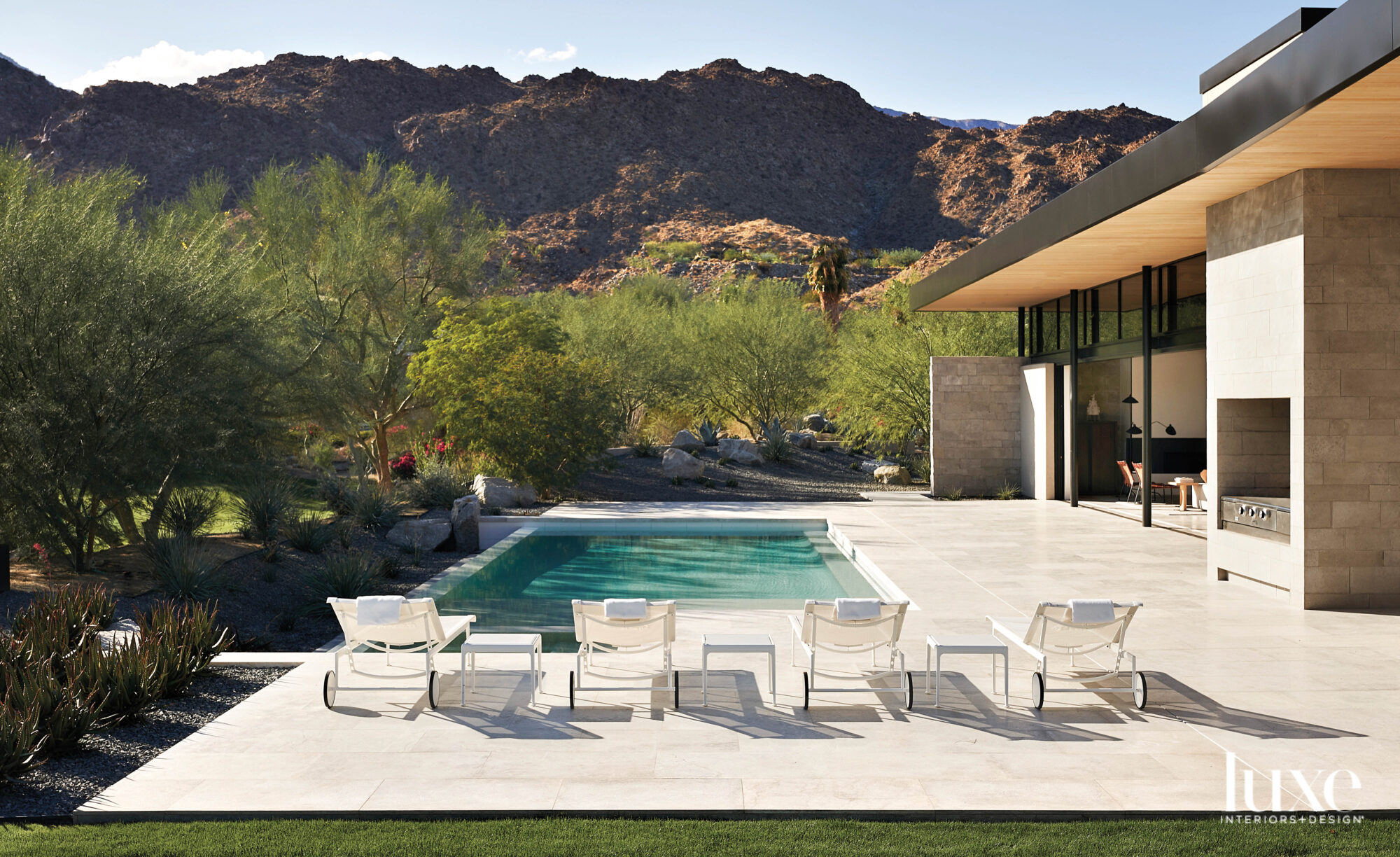 Poolside shot with mountains in...