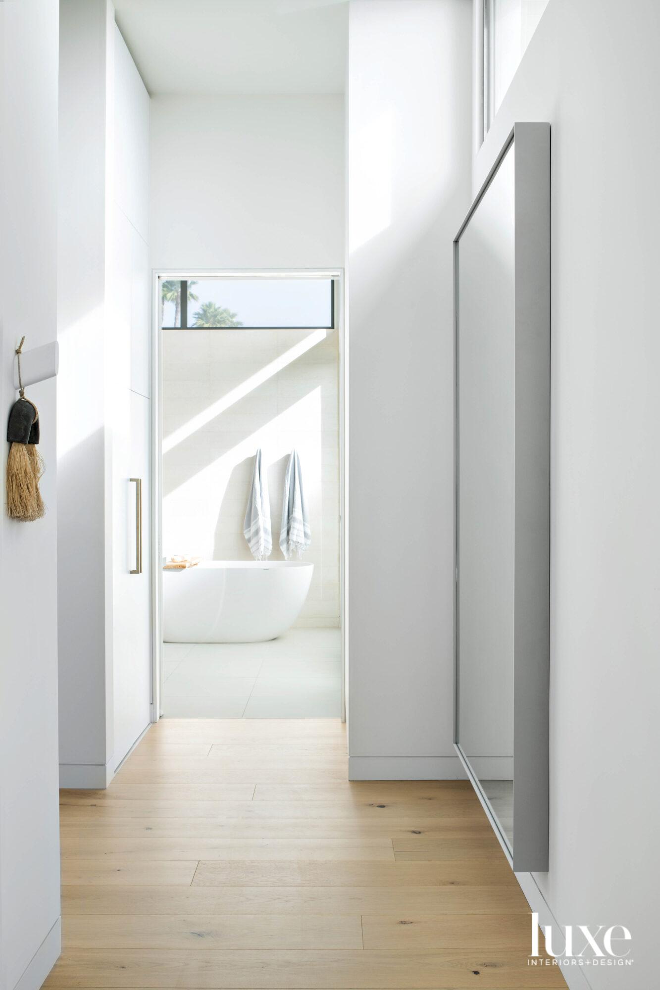 Hallway to main bathroom with...