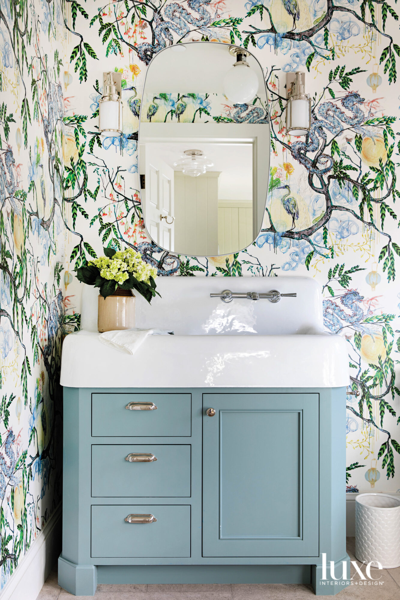 Powder room with blue painted...