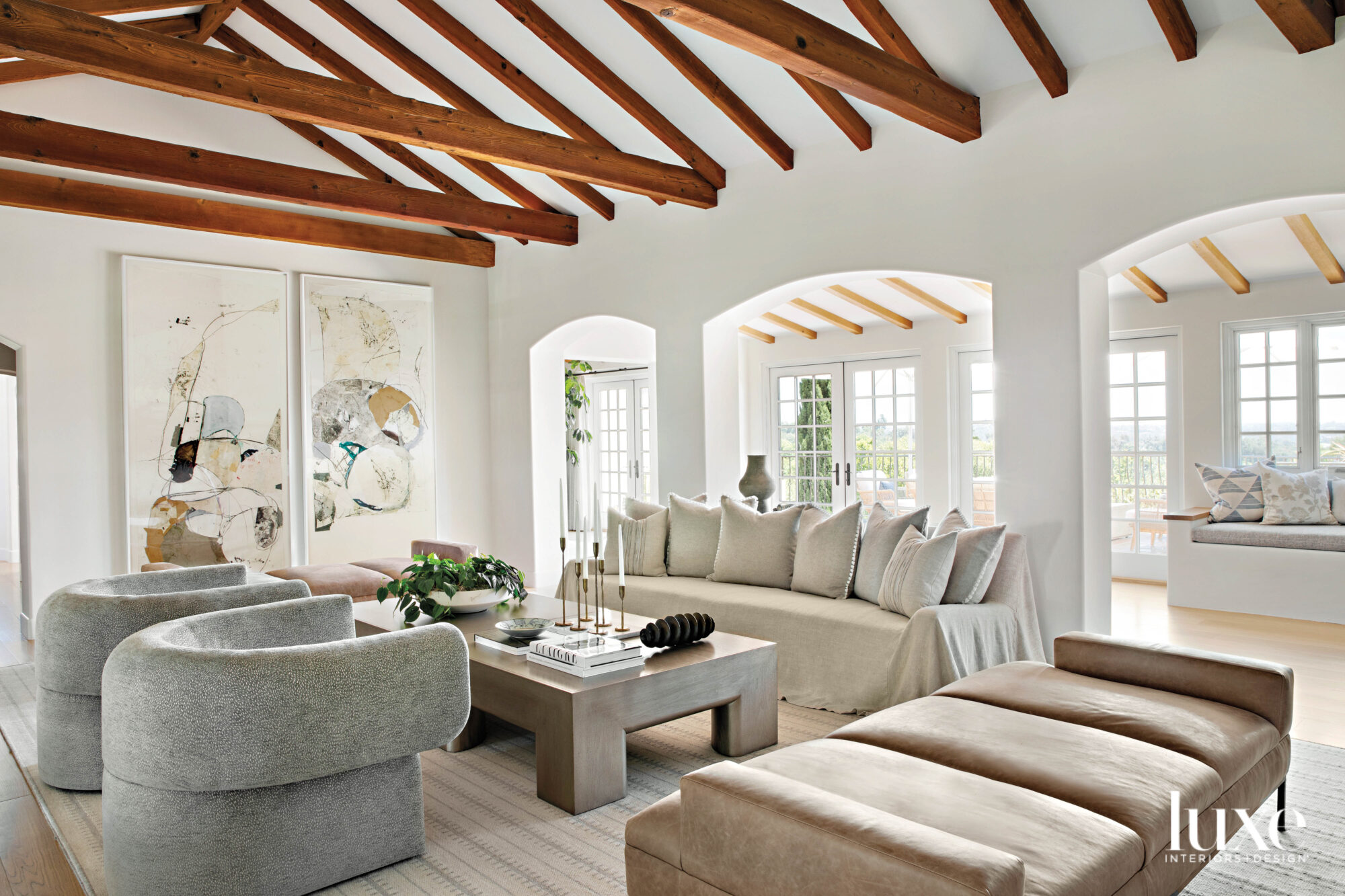 Living room with couches, armchairs,...