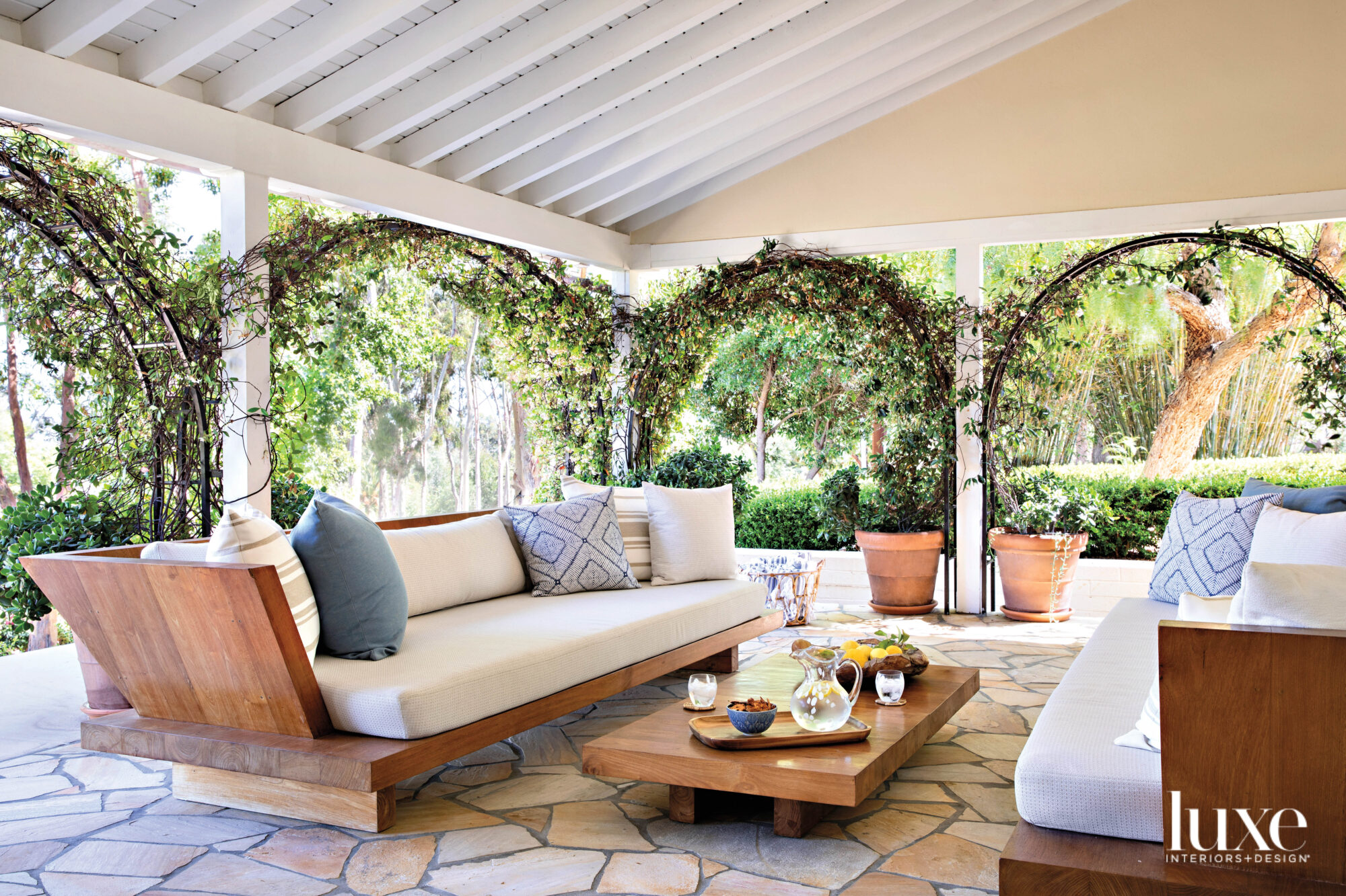 Covered terrace with large couches and coffee table