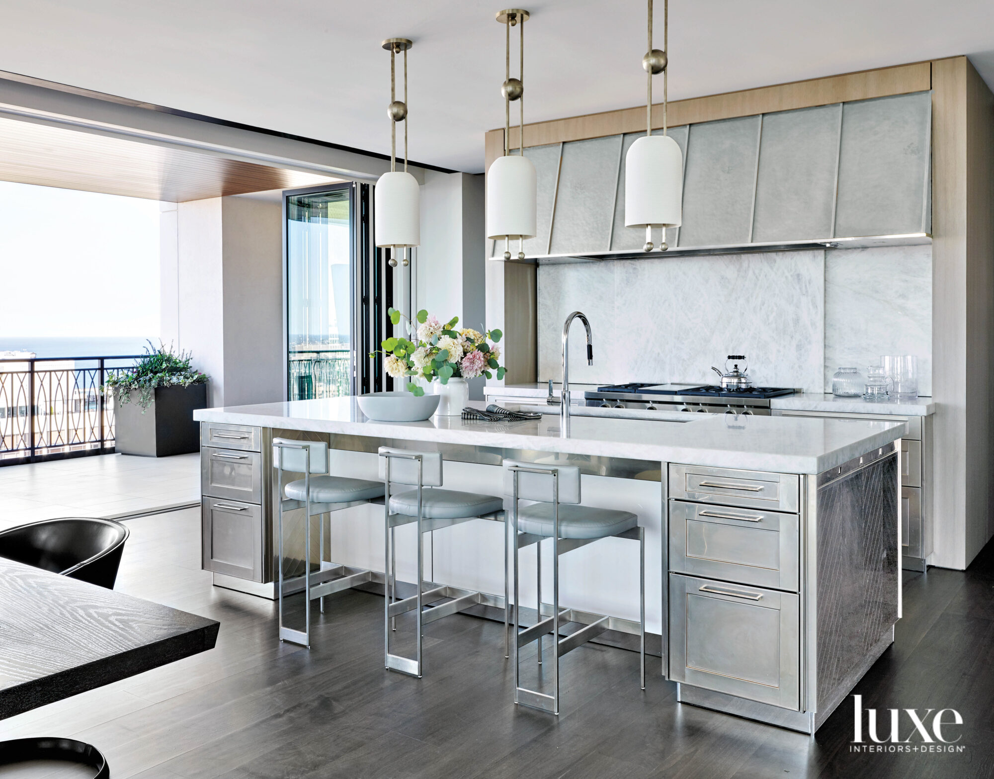 A modern kitchen with satin nickel finish cabinetry.
