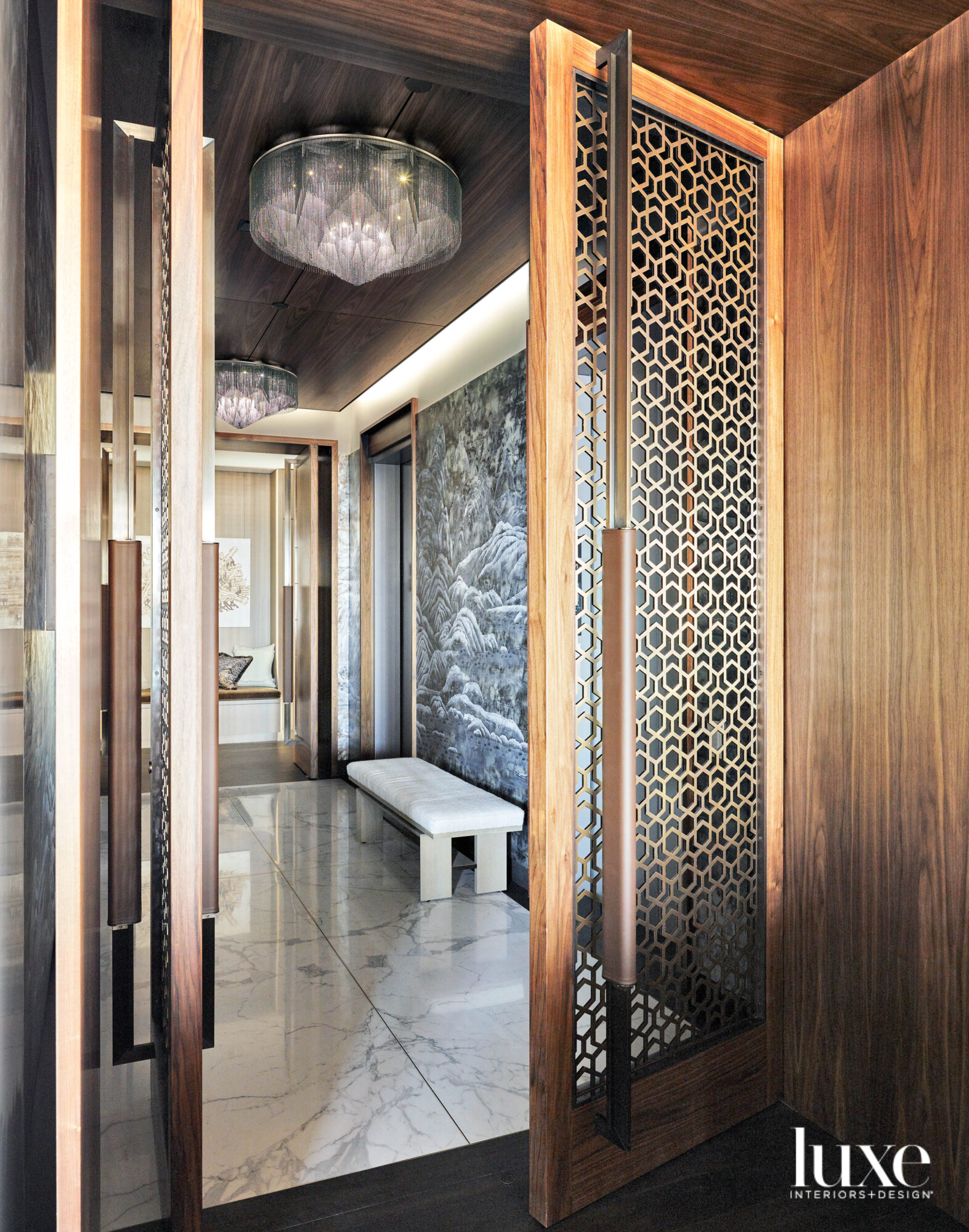 An elevator vestibule with marble...