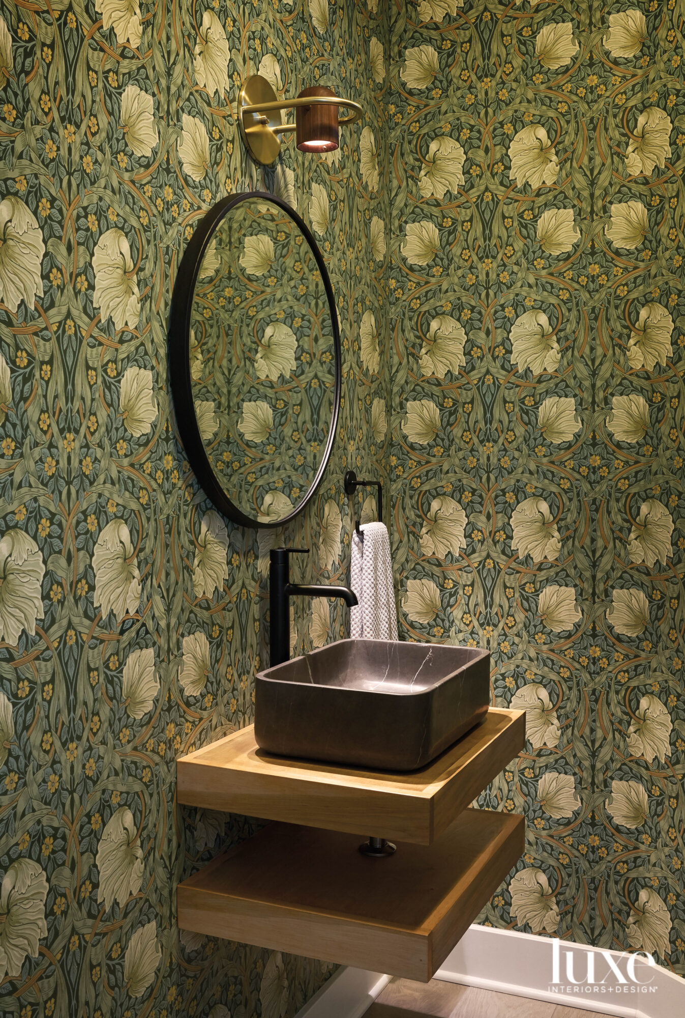 A powder room with floral...