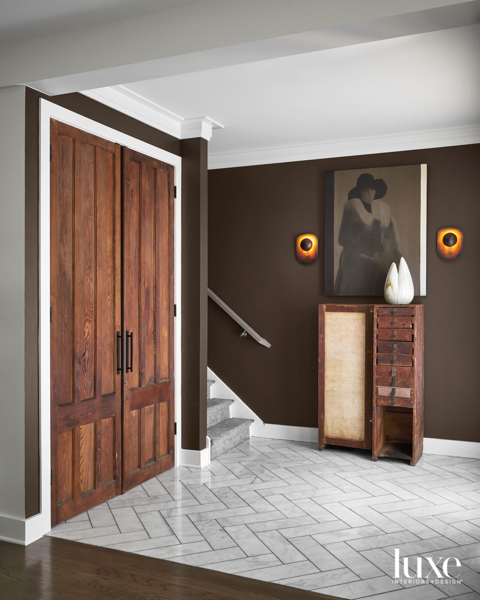 The entry has marble floors and chocolate brown walls.