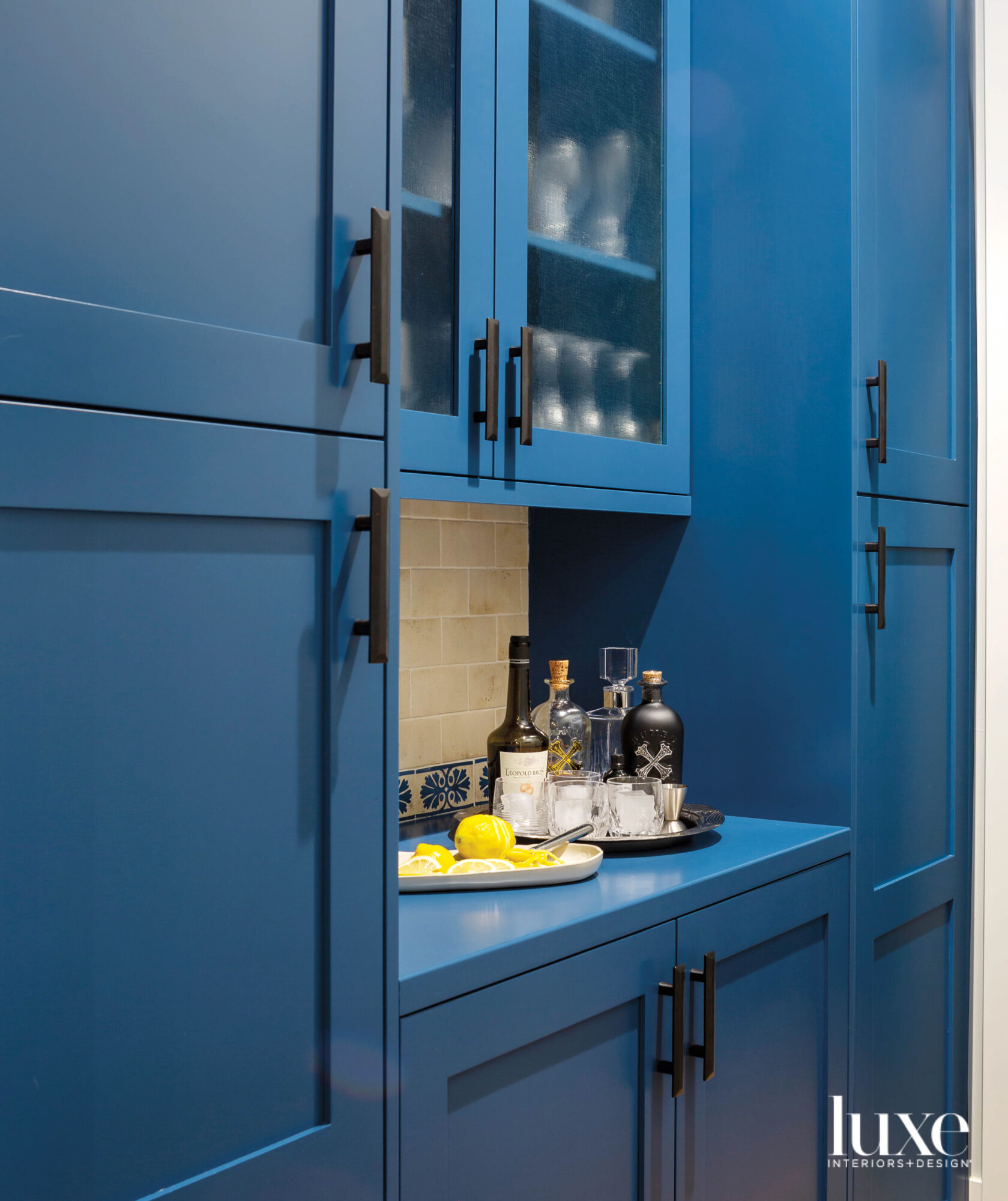 bright blue pantry cabinets and...